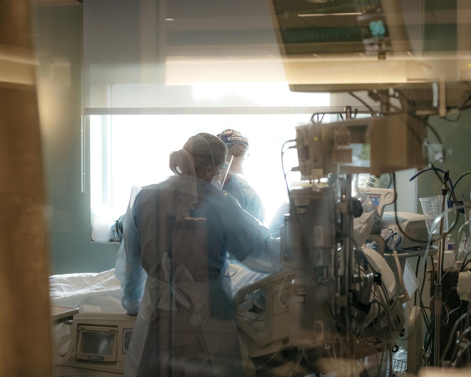 Nurses check on a patient in the ICU Covid-19 ward at NEA Baptist Memorial Hospitalin Jonesboro, Arkansas, on August 4.