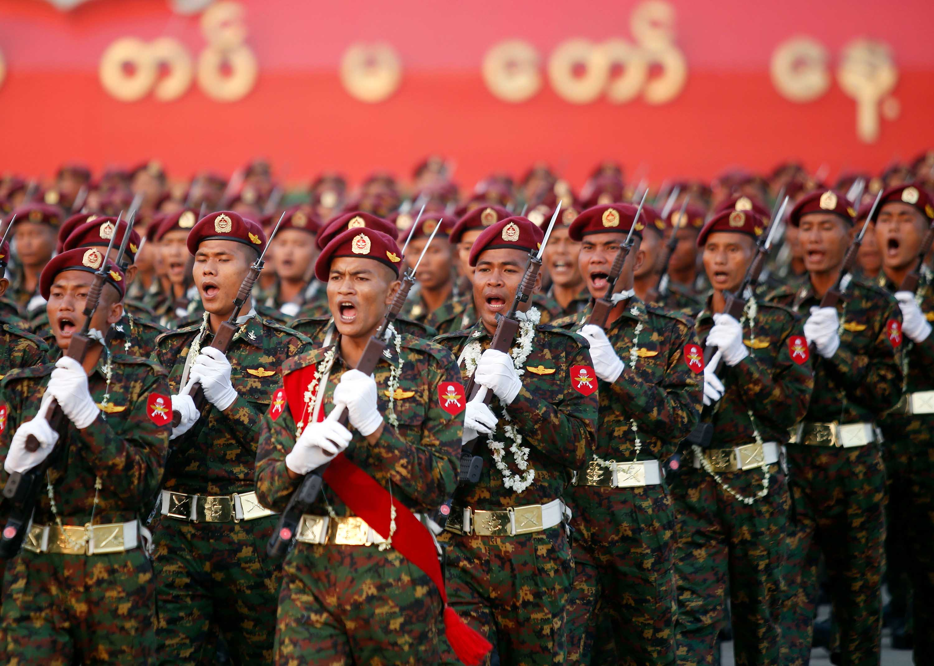 Myanmar soldiers march in formation during a military parade to mark Armed Forces Day in Naypyidaw, Myanmar, in March 2018.