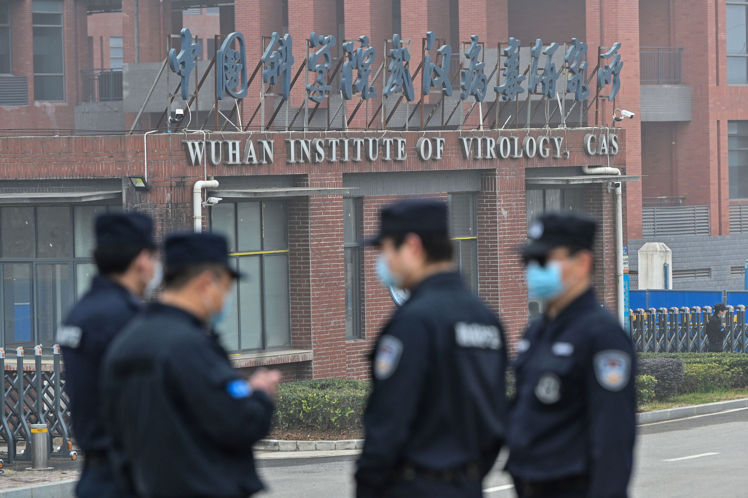 Security personnel stand guard outside the Wuhan Institute of Virology in Hubei province on February 3.