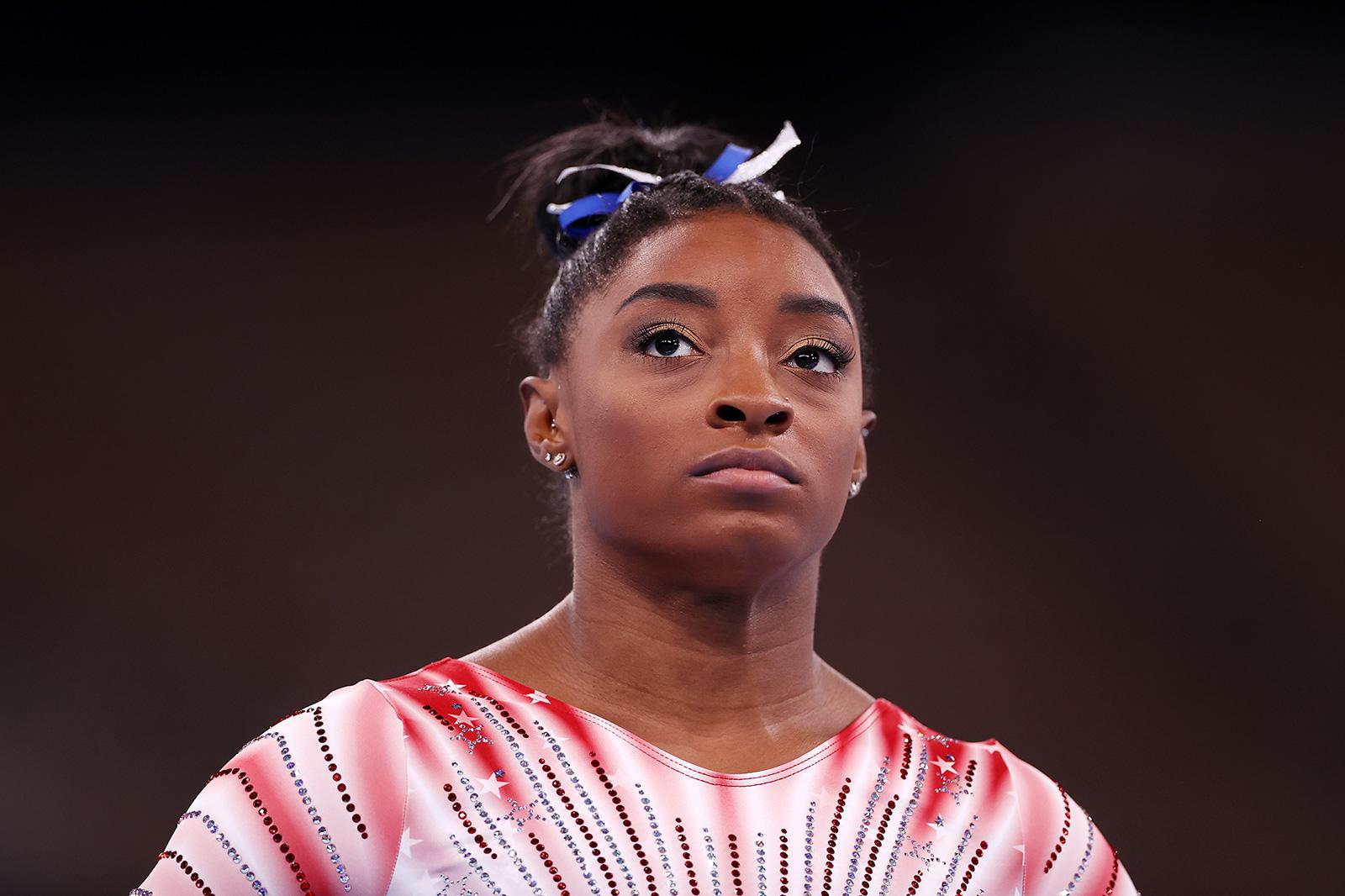 Team USA's Simone Biles watches warm ups prior to the balance beam final on Tuesday.