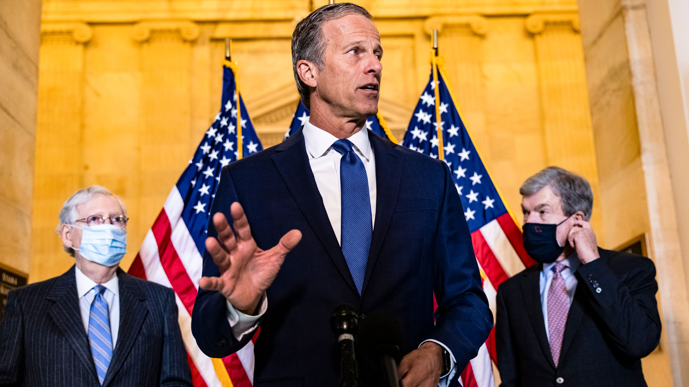 Senate Minority Whip John Thune is flanked by Senate Minority Leader Mitch McConnell, left, and US Sen. Roy Blunt during a news conference on Tuesday.
