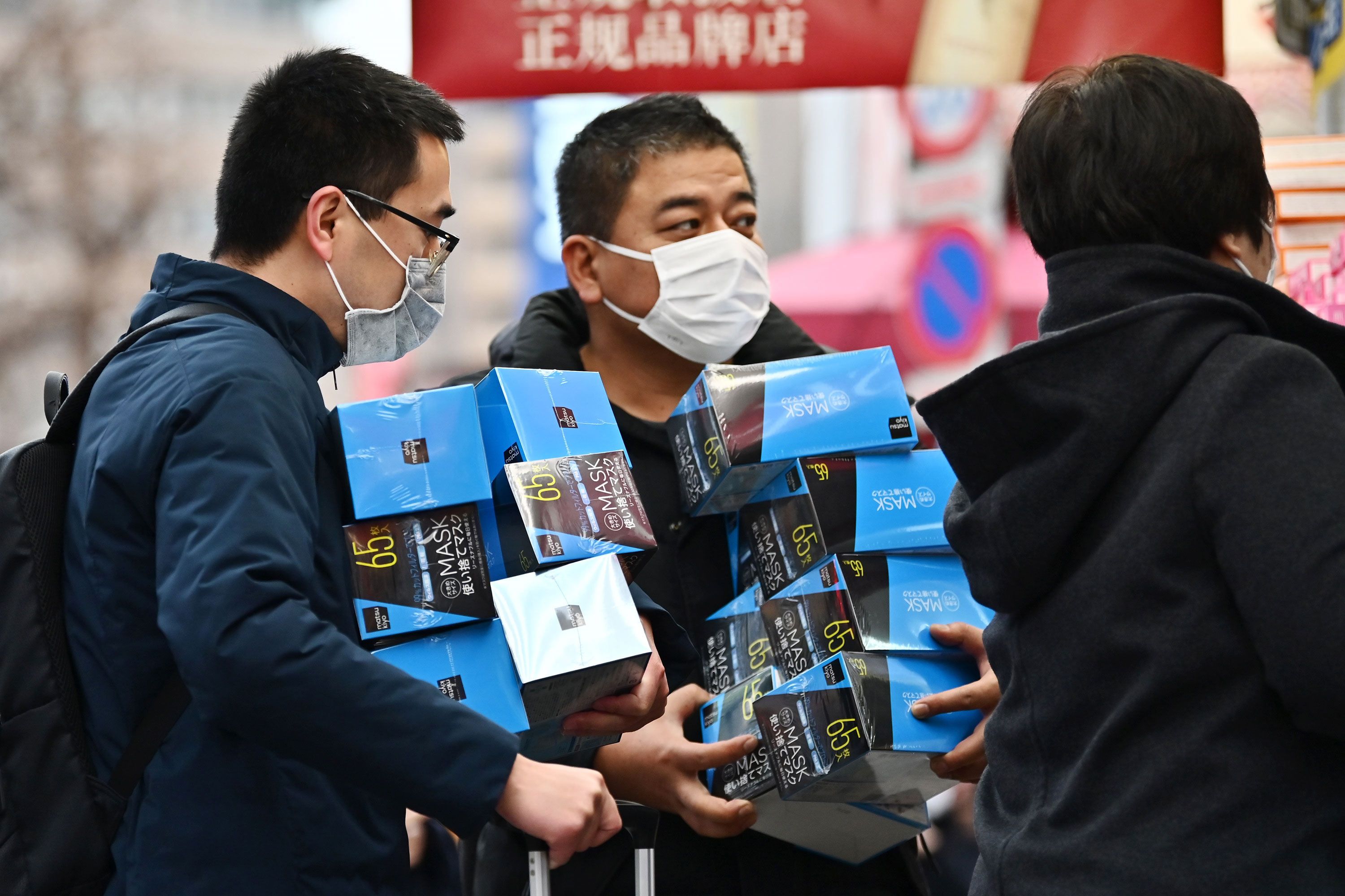 Customers buy face masks from a drugstore in Tokyo's Akihabara district.