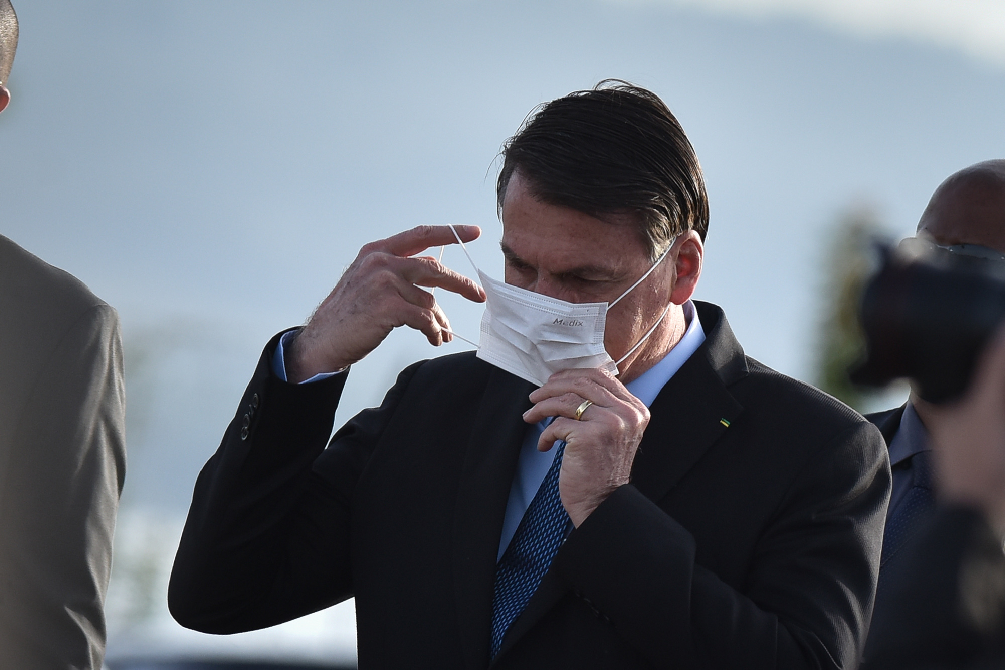 Brazil's President Jair Bolsonaro wears a face mask when arrives for the National Flag Raising ceremony in front of Alvorada Palace amid the coronavirus pandemic, in Brasilia, Brazil, on Tuesday, June 9.