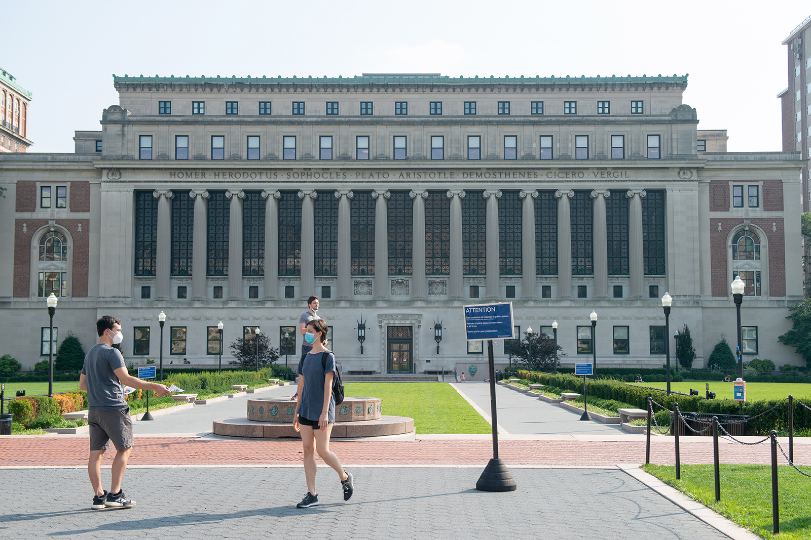 People wearing masks are seen on at Columbia University as the city continues Phase 4 of re-opening following restrictions imposed to slow the spread of coronavirus on August 6, in New York.