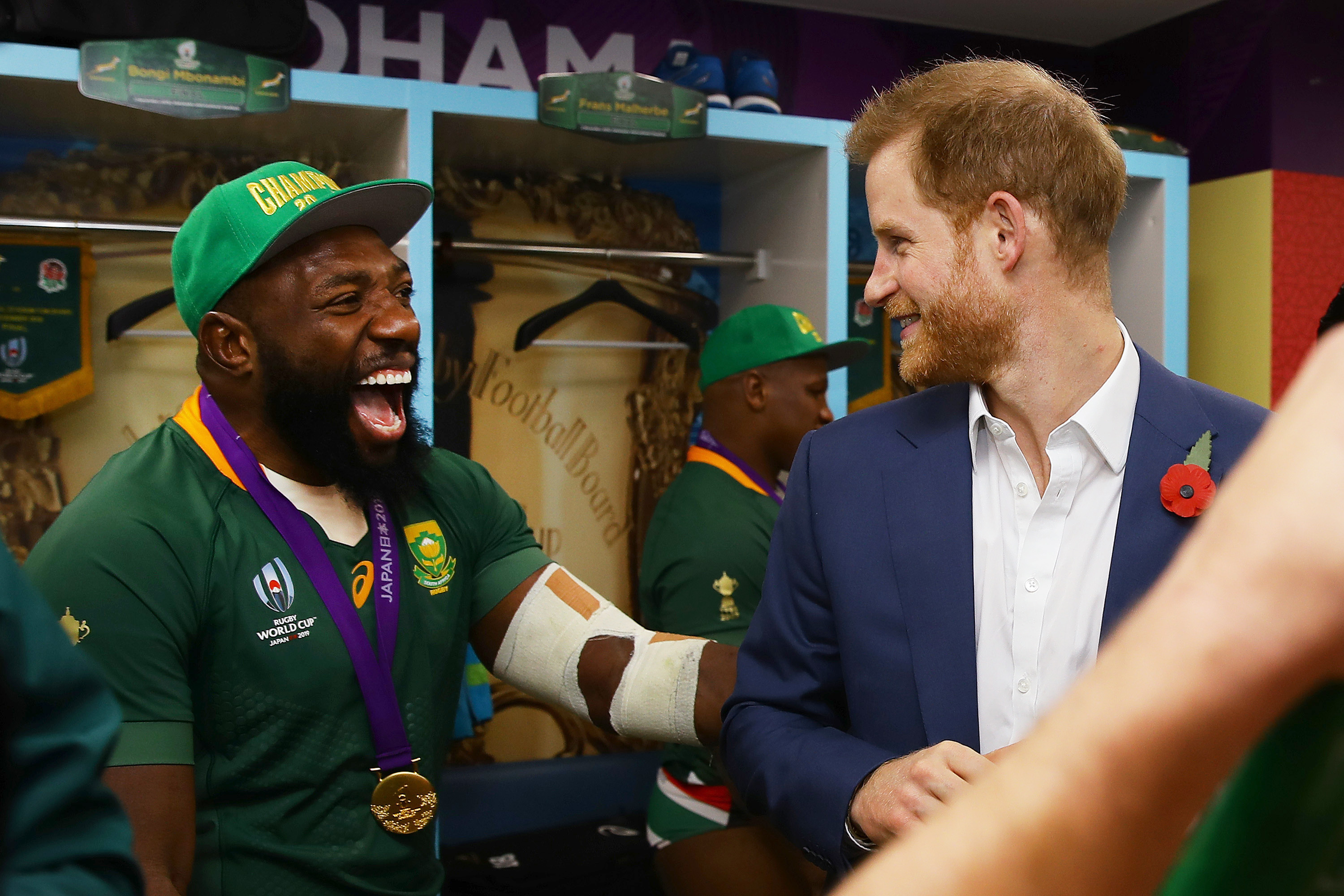 Duke of Sussex shares a joke with Tendai Mtawarira of South Africa following his team's victory against England. Handout/World Rugby via Getty Image