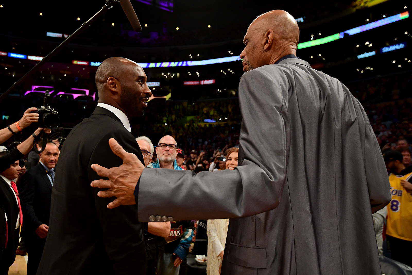 Kobe Bryant, left, greets Kareem Abdul-Jabbar after both of their Los Angeles Lakers jerseys were retired in 2017.