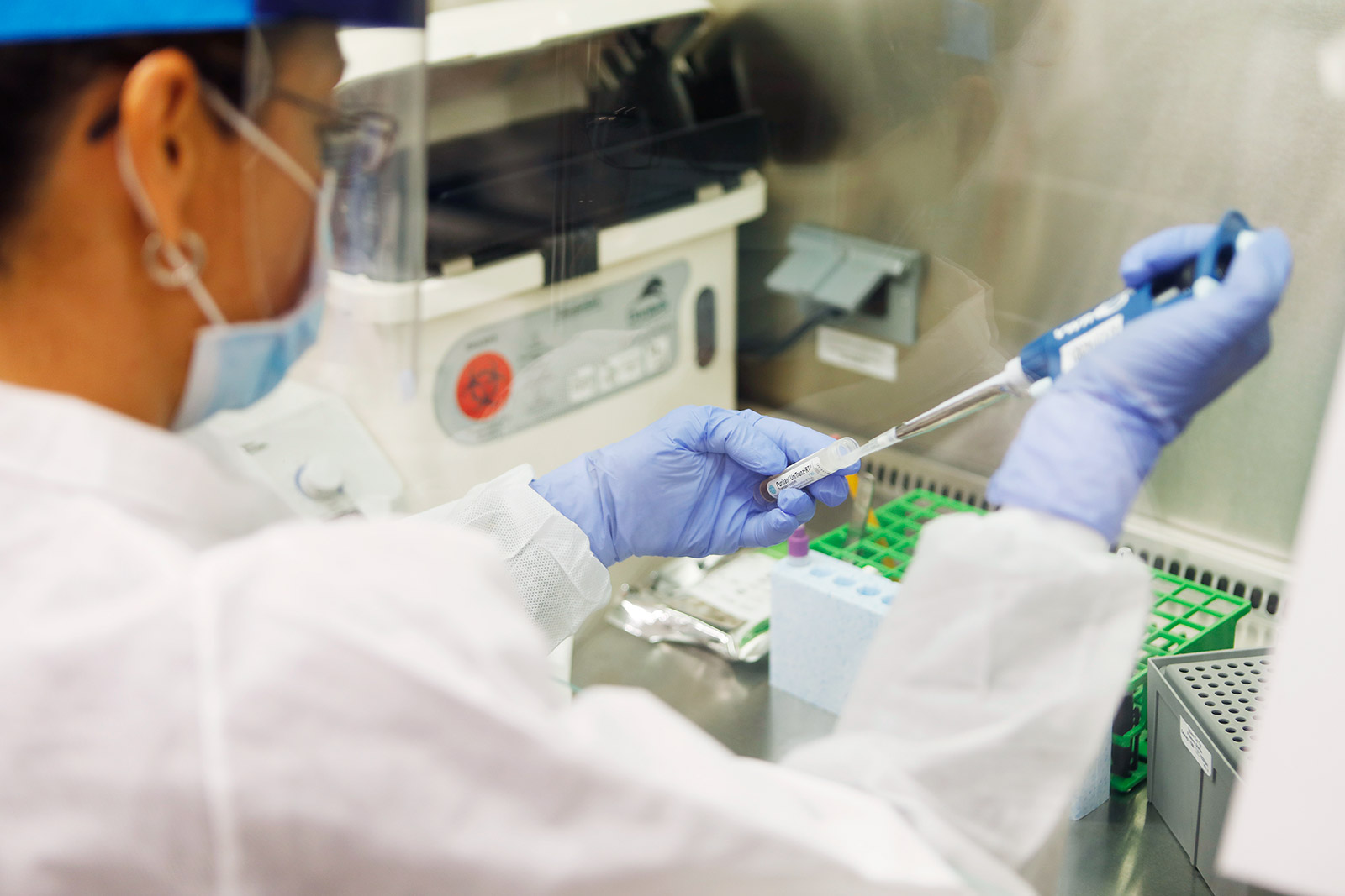 A medical technologist processes coronavirus test samples at a lab in Tampa, Florida, on June 25.