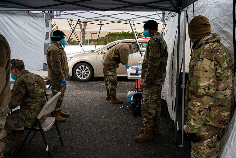 Washington National Guard personnel prepare to administer COVID-19 vaccinations to patients at Town Toyota Center on January 26, in Wenatchee, Washington.