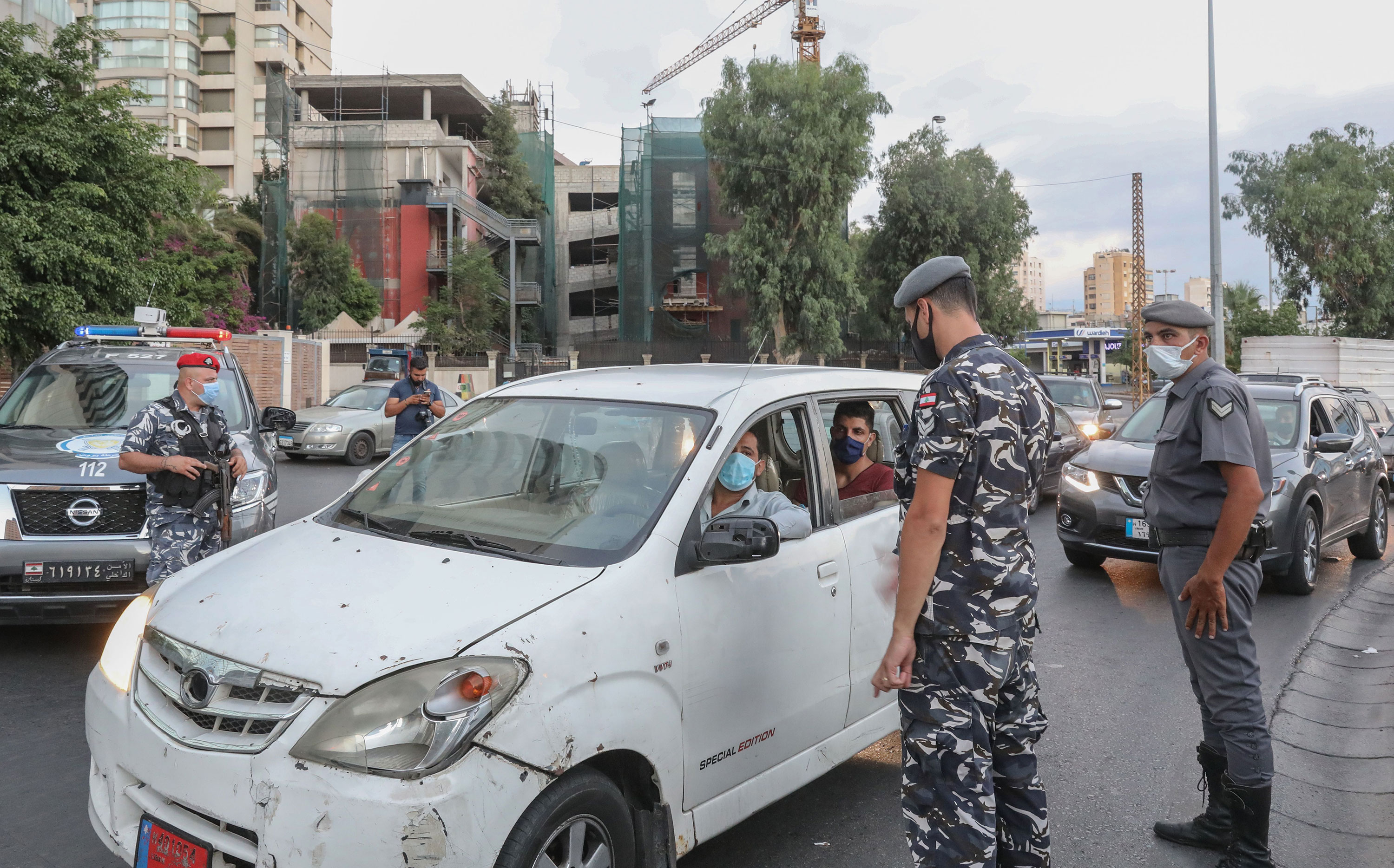 Lebanese security force officers man a checkpoint to verify the compliance with restrictions on the first day of a reinstated lockdown to combat a surge in Covid-19 cases on August 21 in Beirut, Lebanon.