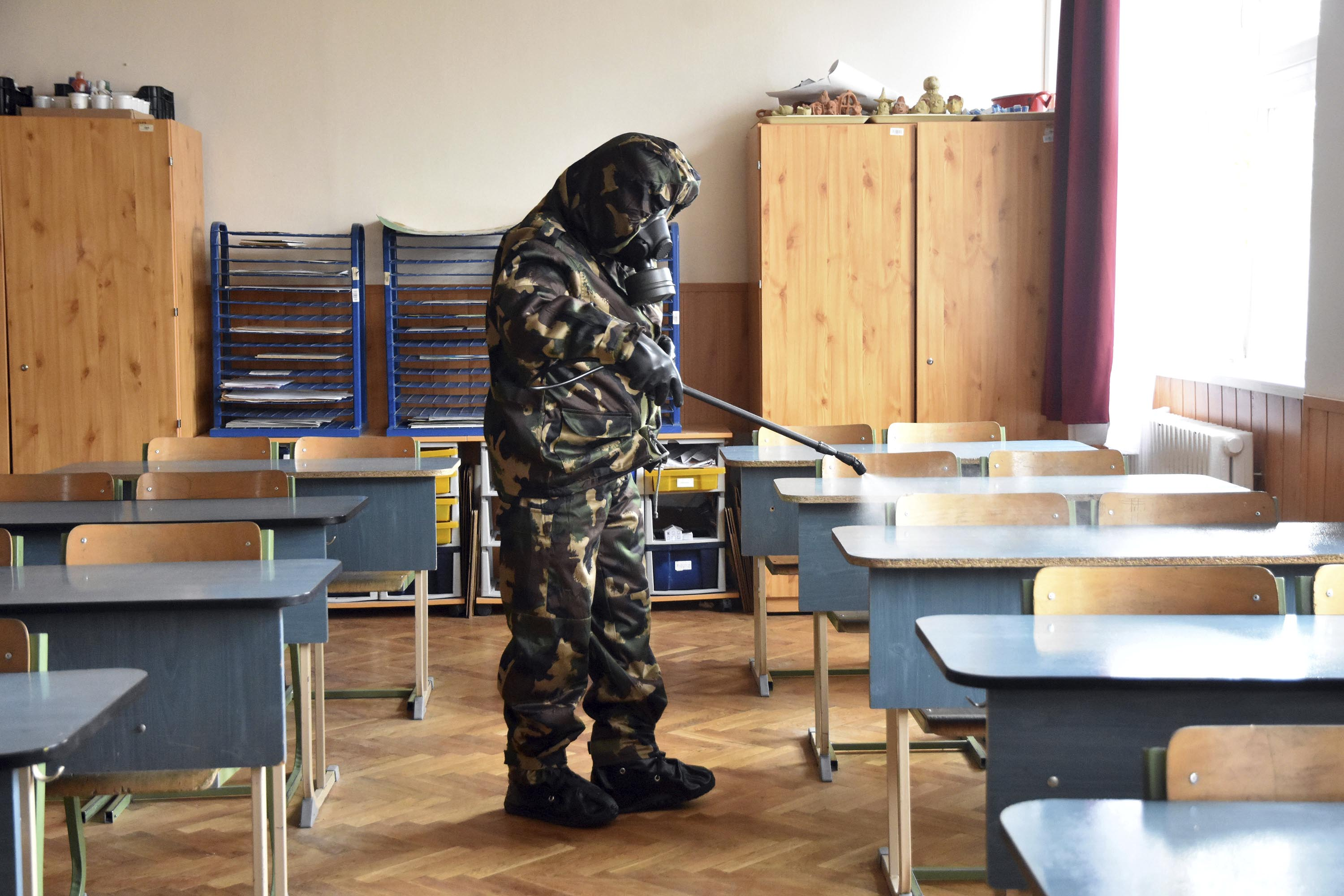 A Hungarian soldier disinfects a classroom at an elementary school in Szolnok, Hungary, on October 26.