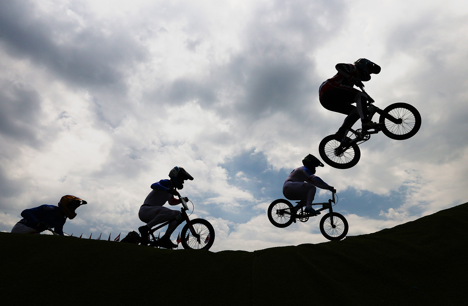 Sylvain Andre and Romain Mahieu of Team France, and Connor Fields of the US compete in the BMX semifinals on Friday in Tokyo.