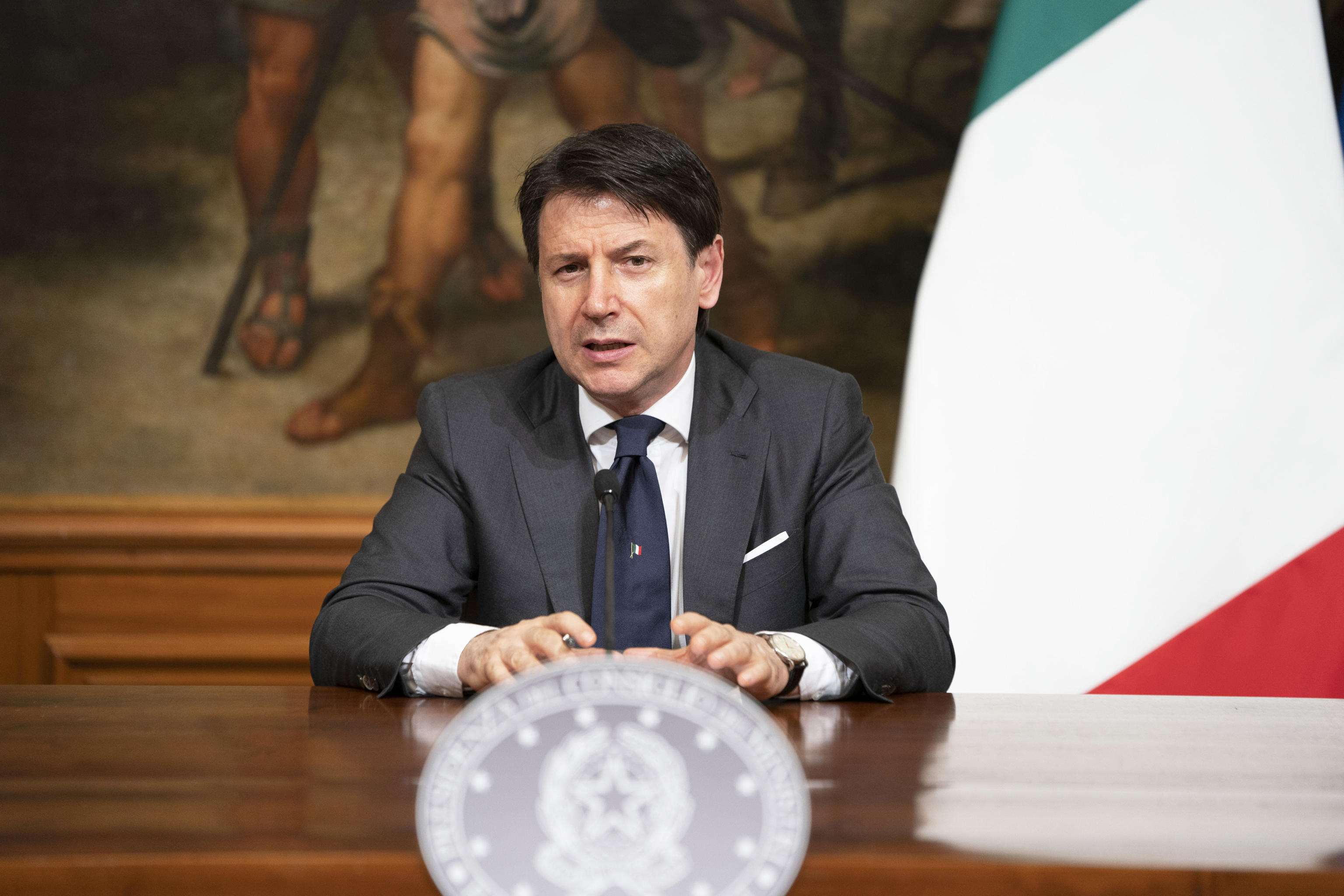 Italian Prime Minister Giuseppe Conte attends a press conference at Chigi Palace in Rome, on June 11.