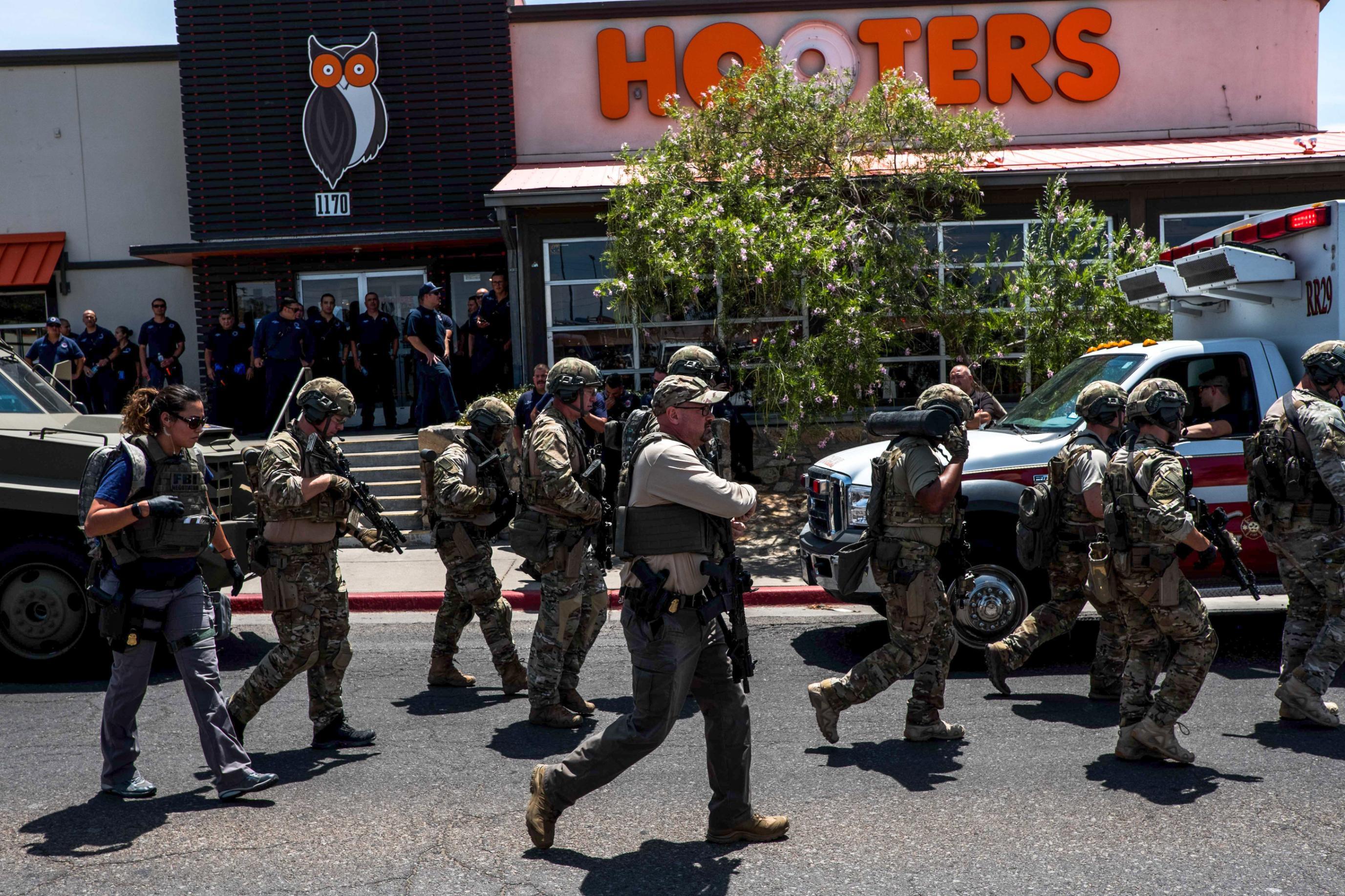 Law enforcement agencies respond to the shooting in El Paso.