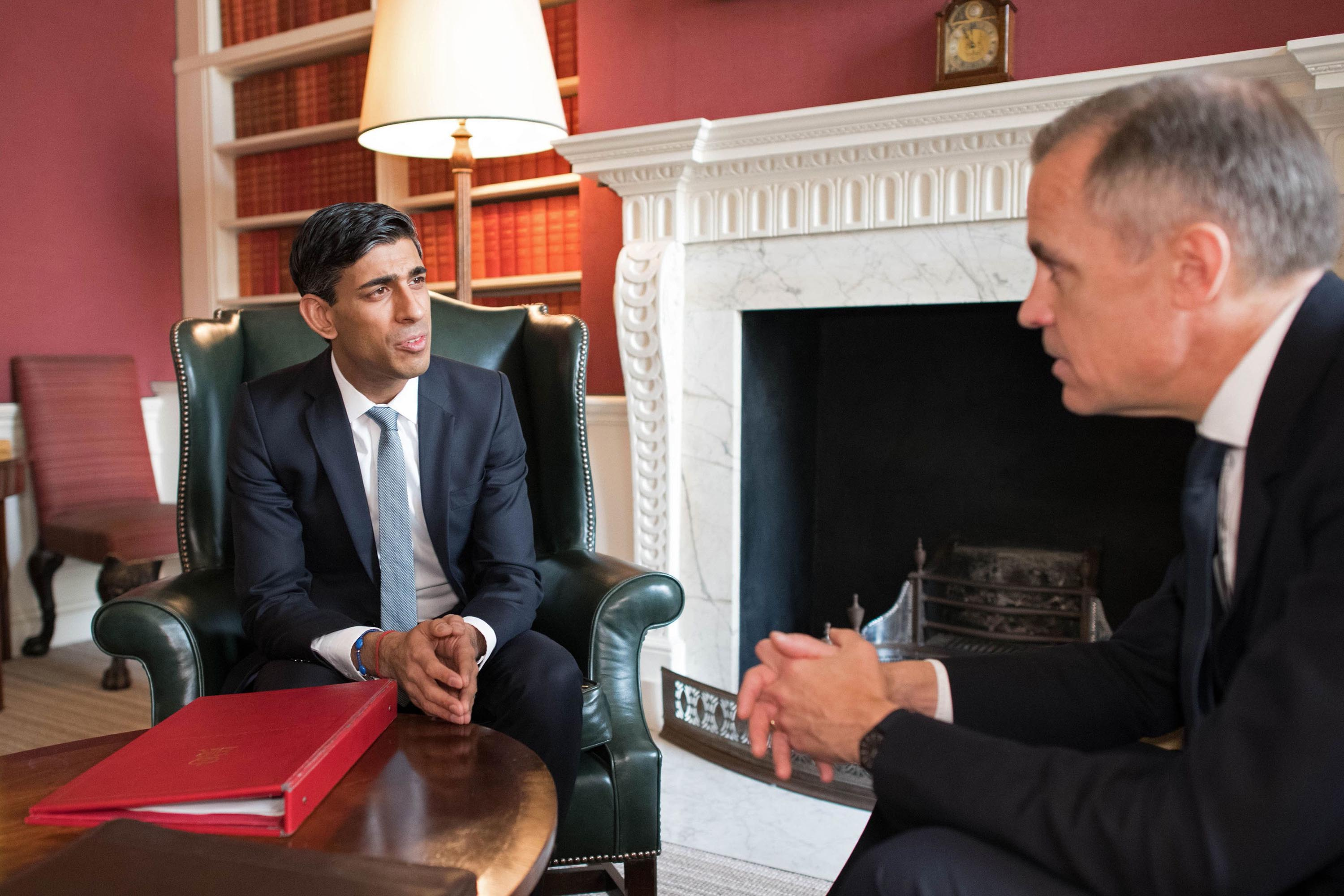 Britain's Chancellor of the Exchequer Rishi Sunak, left, speaks with Mark Carney, Governor of the Bank of England in London, England, on March 11.