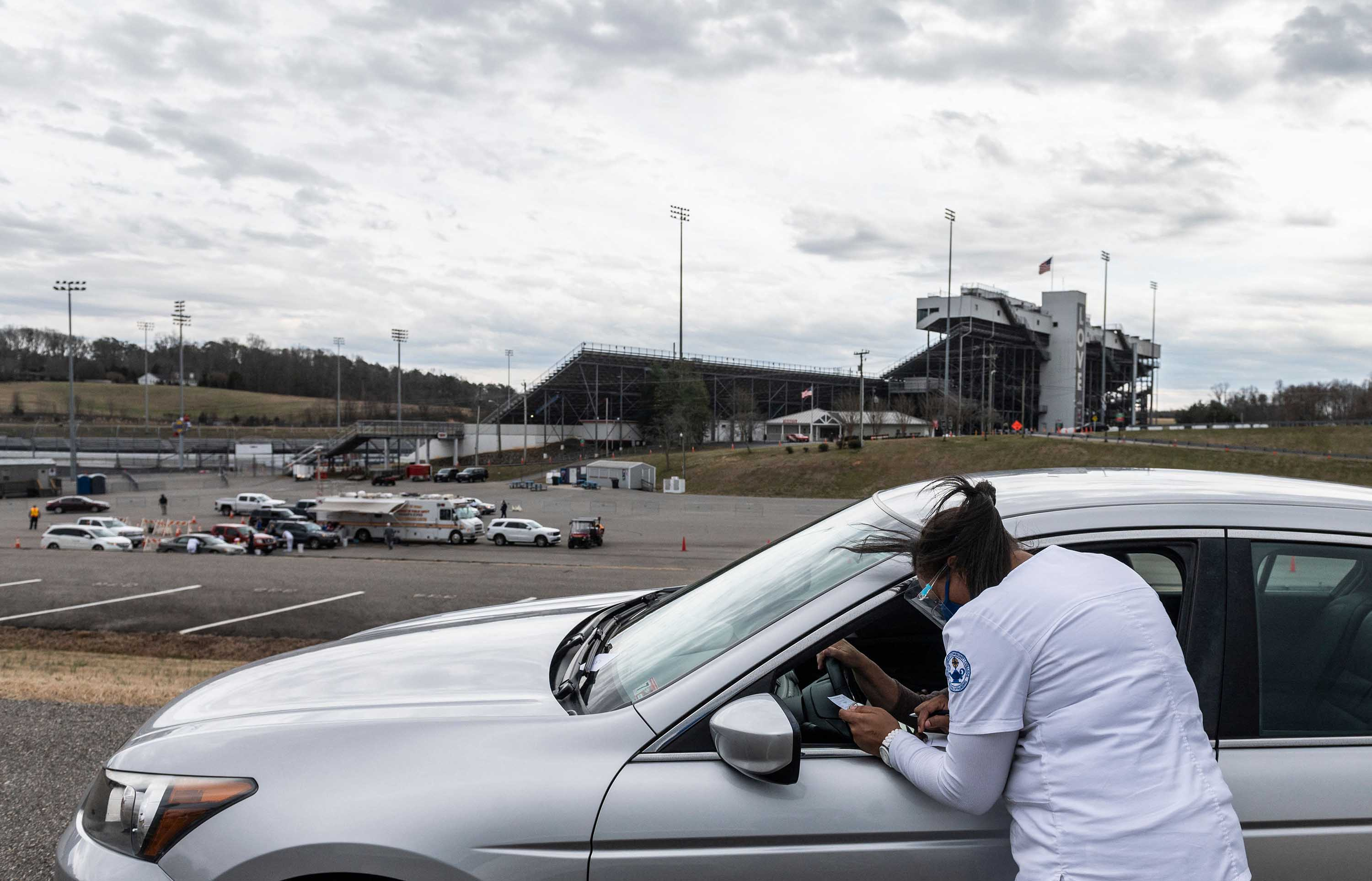 A nurse speaks to a vaccine recipient at the Martinsville speedway Covid-19 vaccination site in place for residents in the rural area around Ridgeway, Virginia, on March 12.