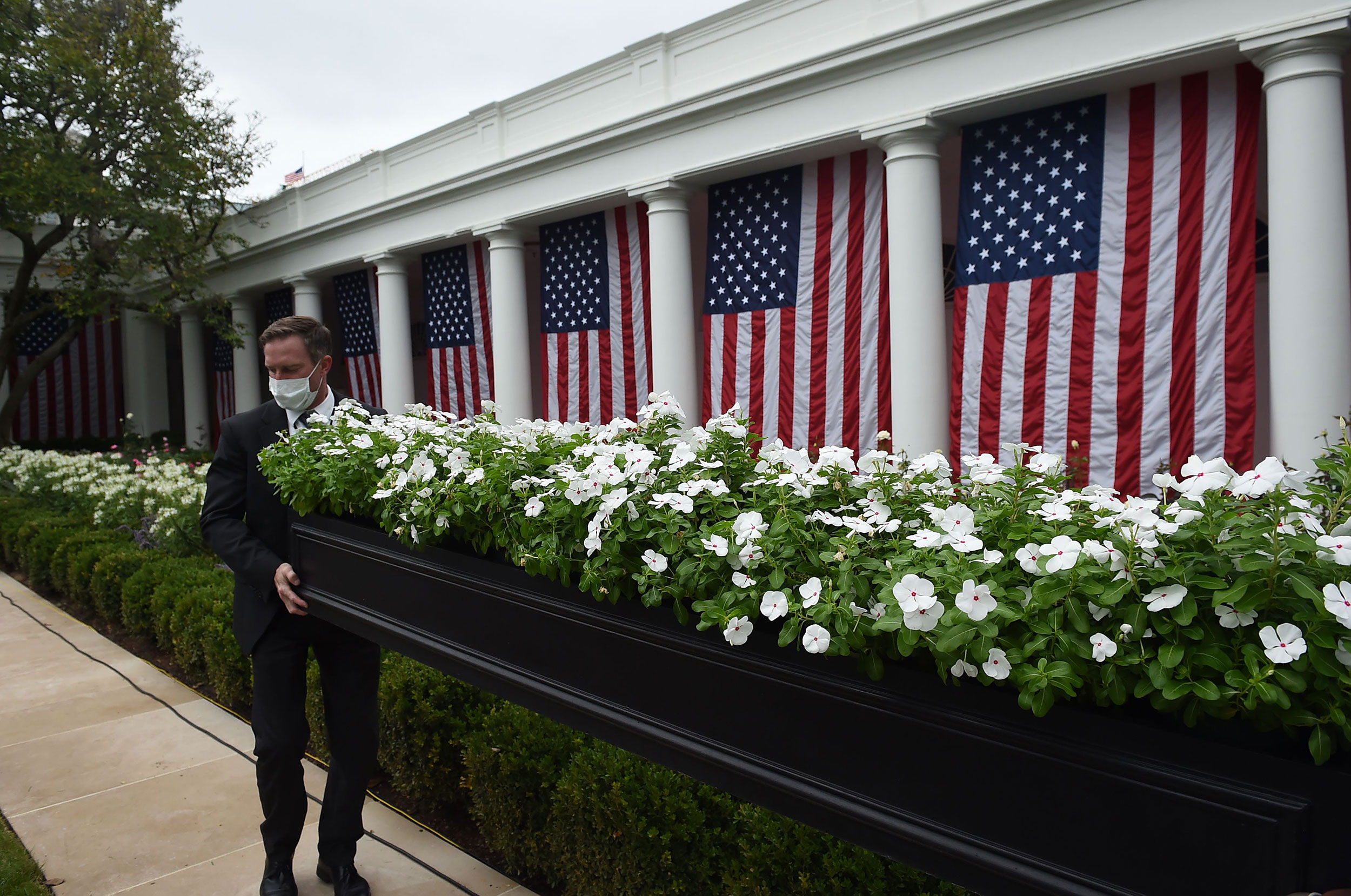 White House staff prepare the Rose Garden ahead of President Trump's scheduled Supreme Court nomination announcement on Saturday.