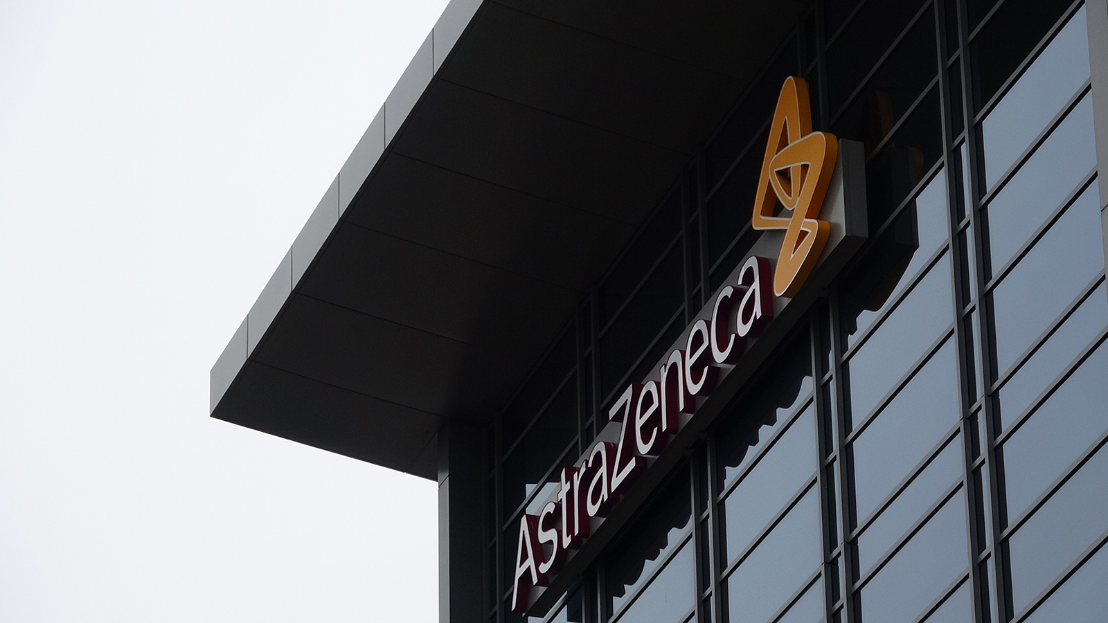 Facade with logo at office of pharmaceutical company AstaZeneca, in San Francisco, on April 11.