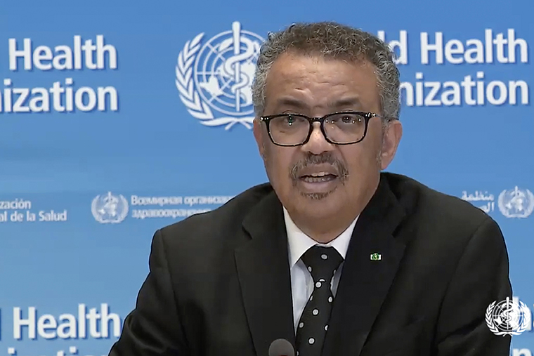 A tv grab taken from the World Health Organization website shows WHO Chief Tedros Adhanom Ghebreyesus delivering a virtual news briefing at the WHO headquarters in Geneva on Monday, March 23.