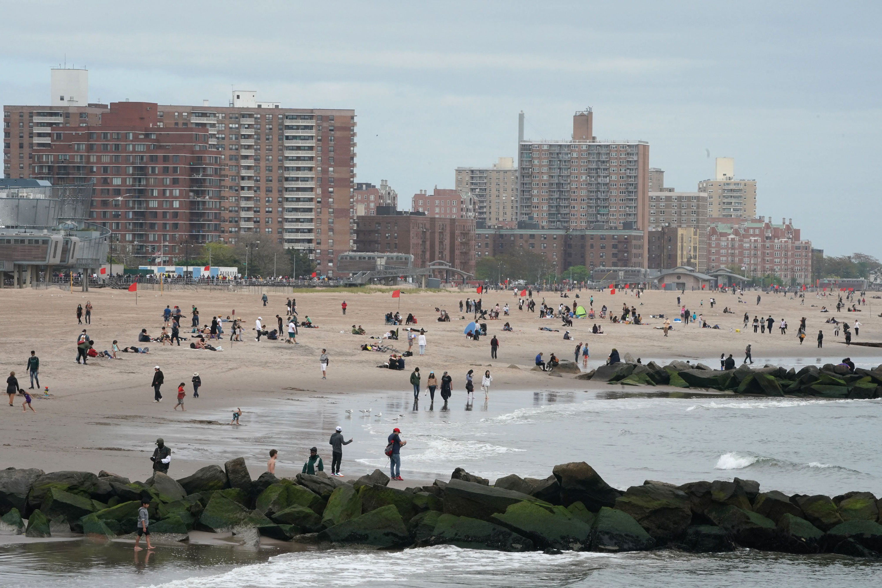 People gather on a beach at Coney Island on May 24 in New York.