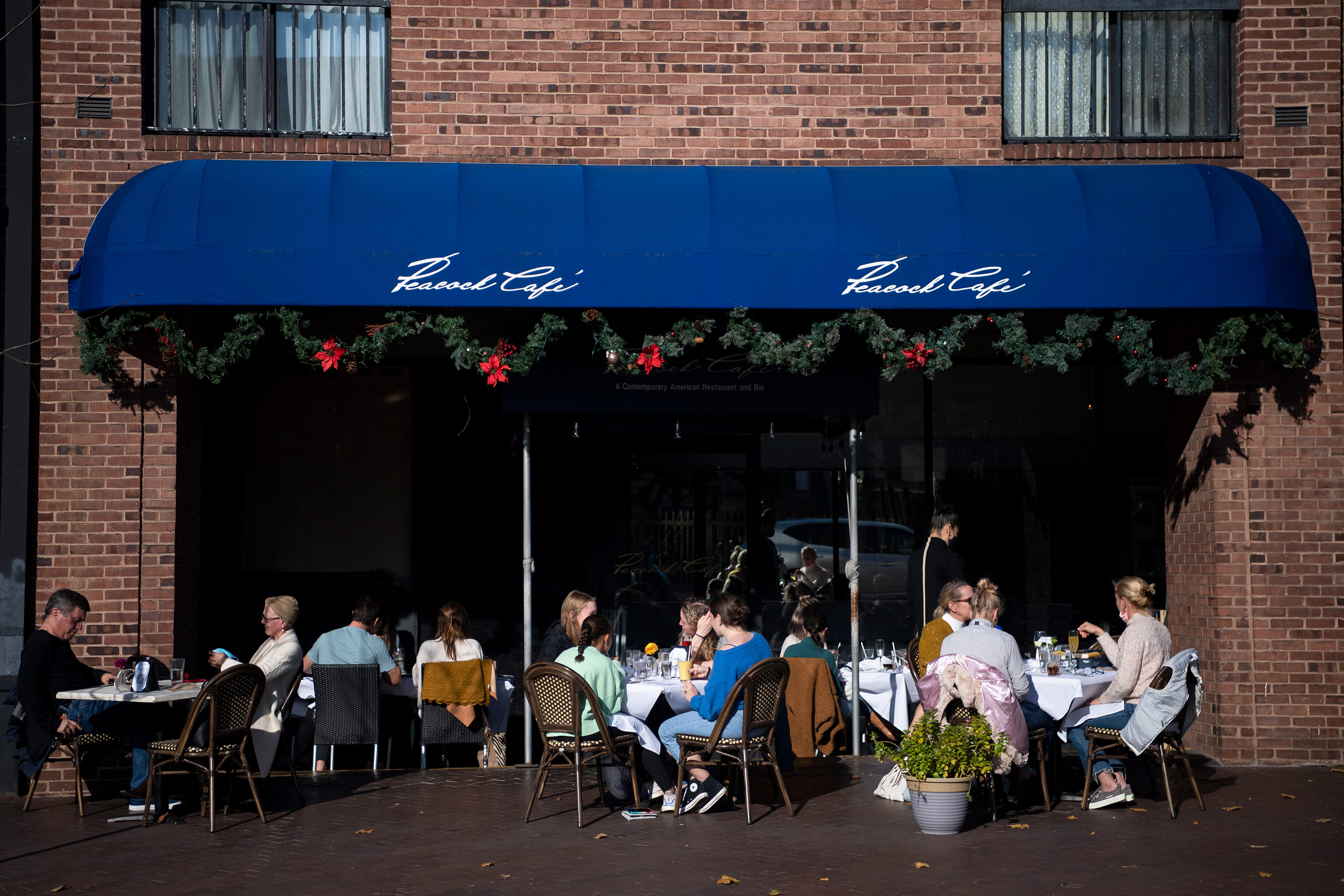 People dine outside at Peacock Cafe on November 28, 2020 in Washington, DC