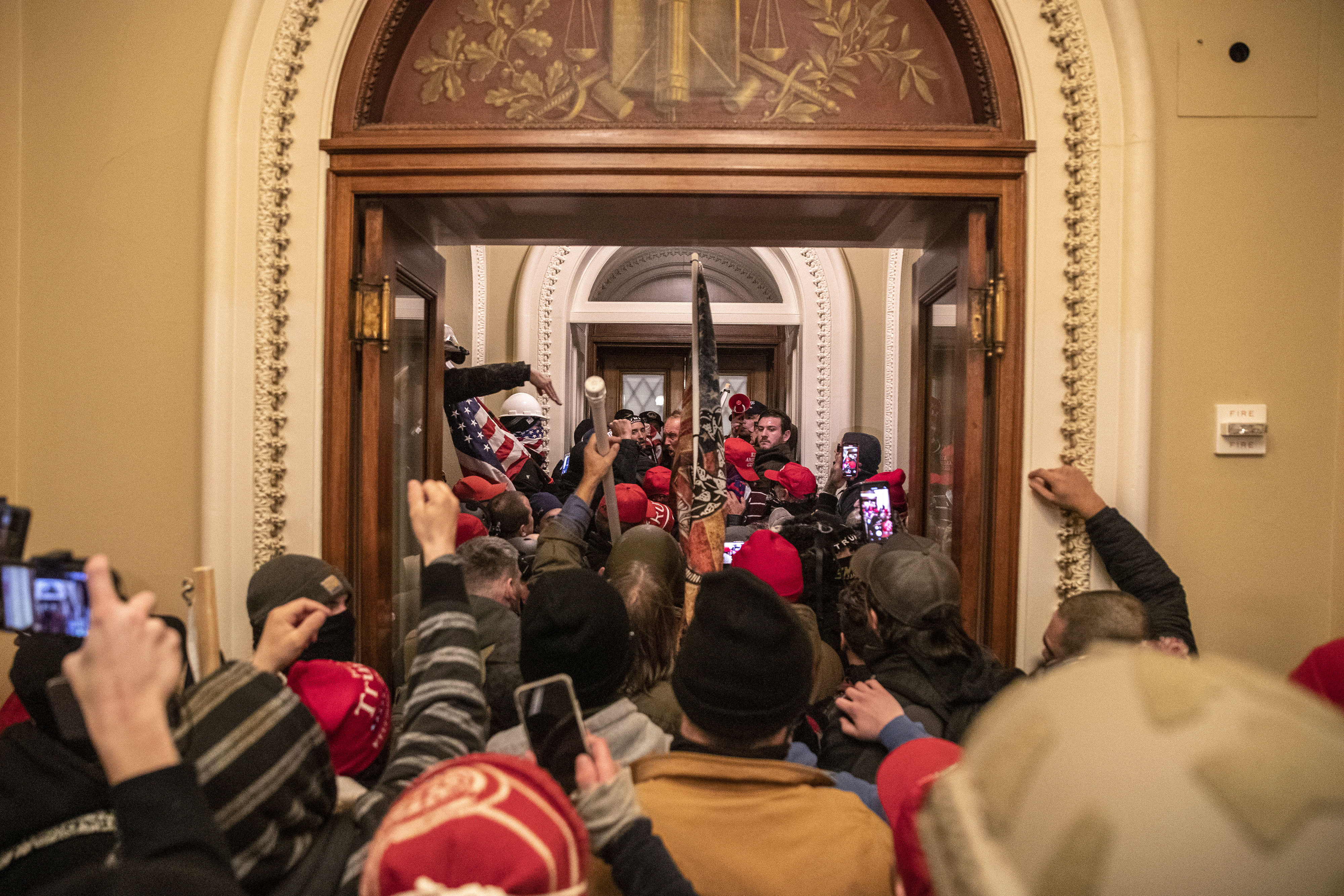 Rioters walk through the Capitol after breaching barricades to the building on January 6.