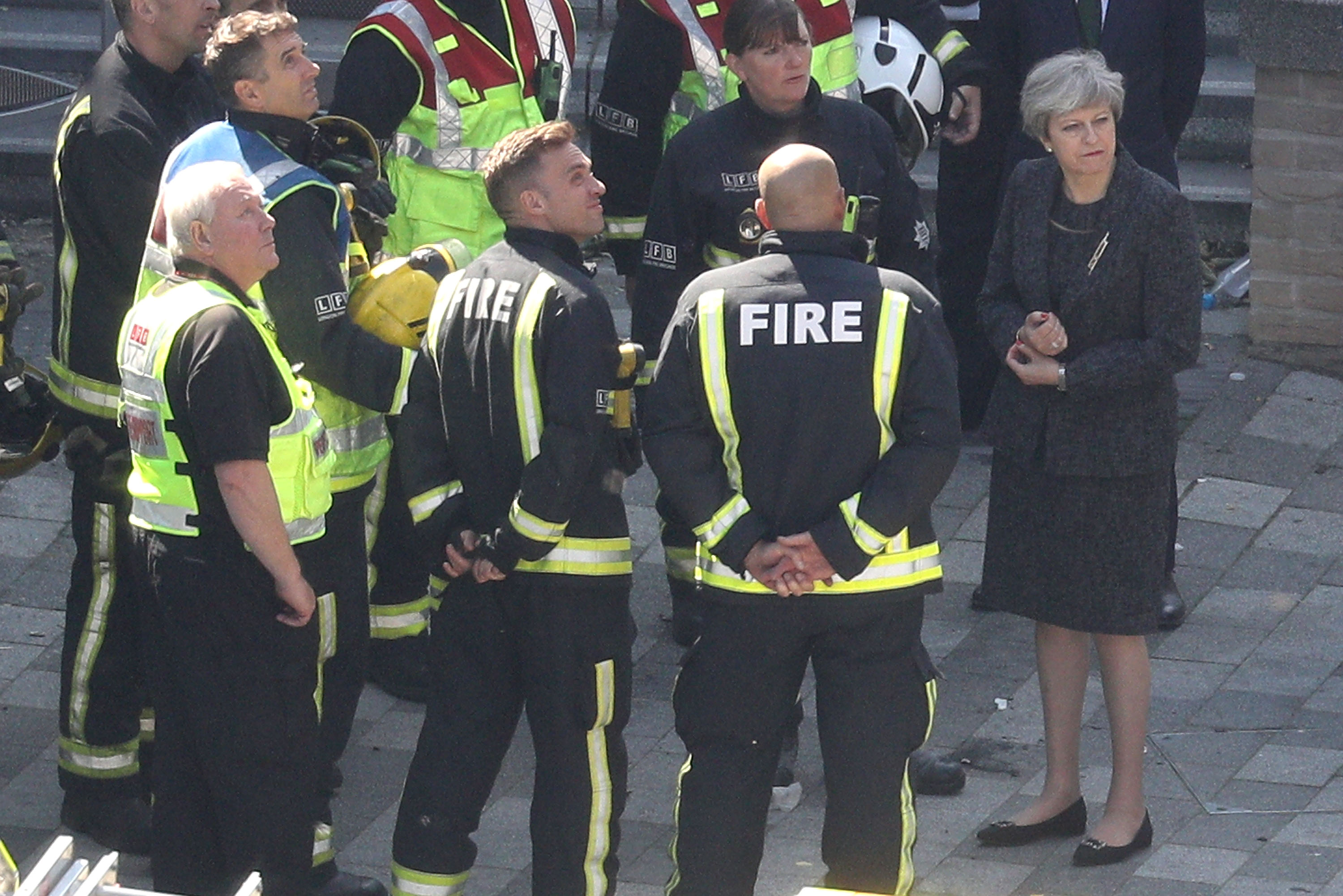 May meets with firefighters after the Grenfell Tower fire -- but her initial failure to meet survivors prompted criticism.