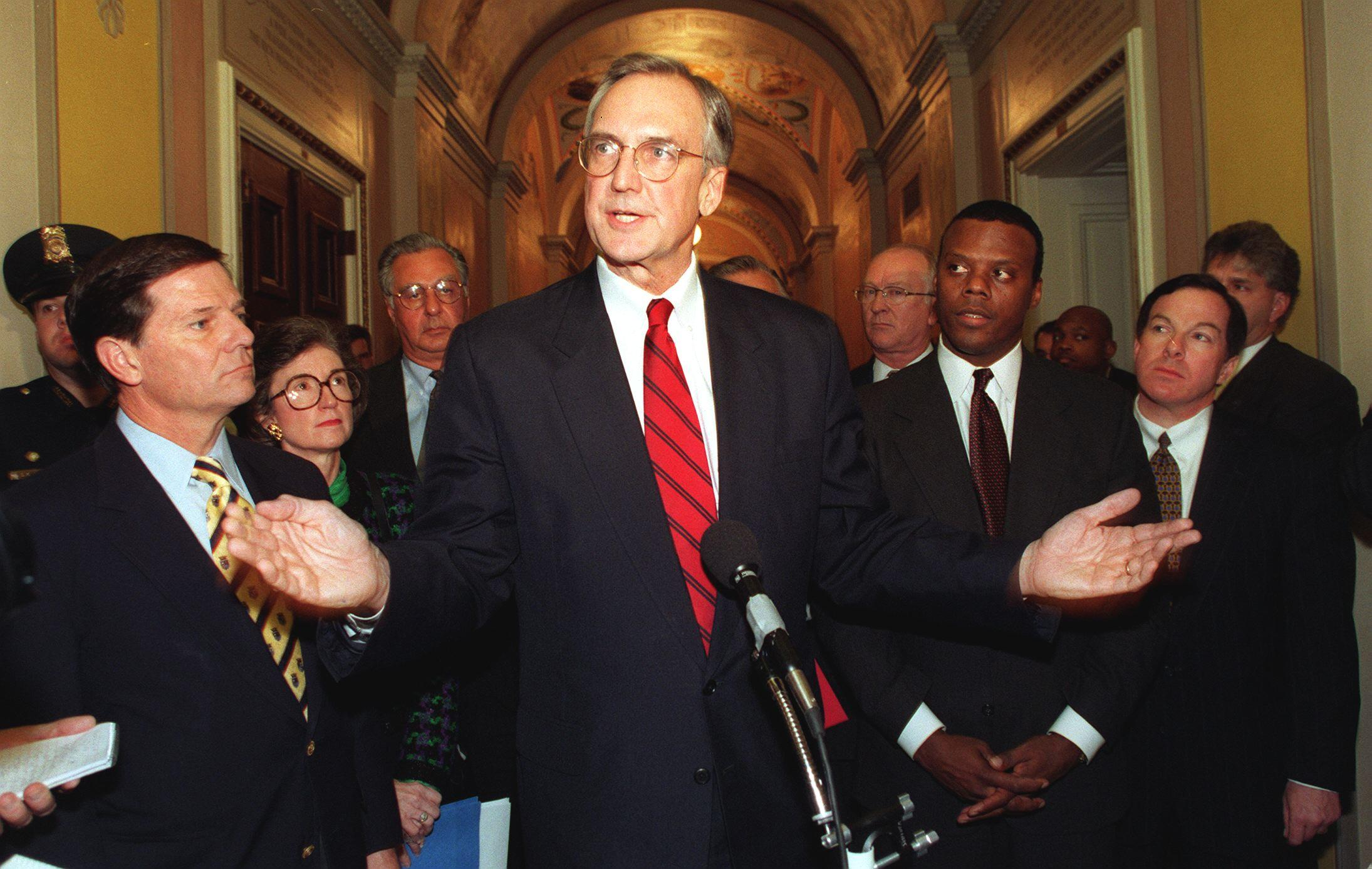 Robert Livingston speaks to the media ahead of the hearings on the impeachment of then-President Bill Clinton.