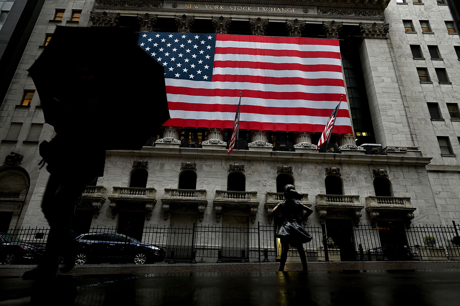 A woman walks past the New York Stock Exchange on March 19.