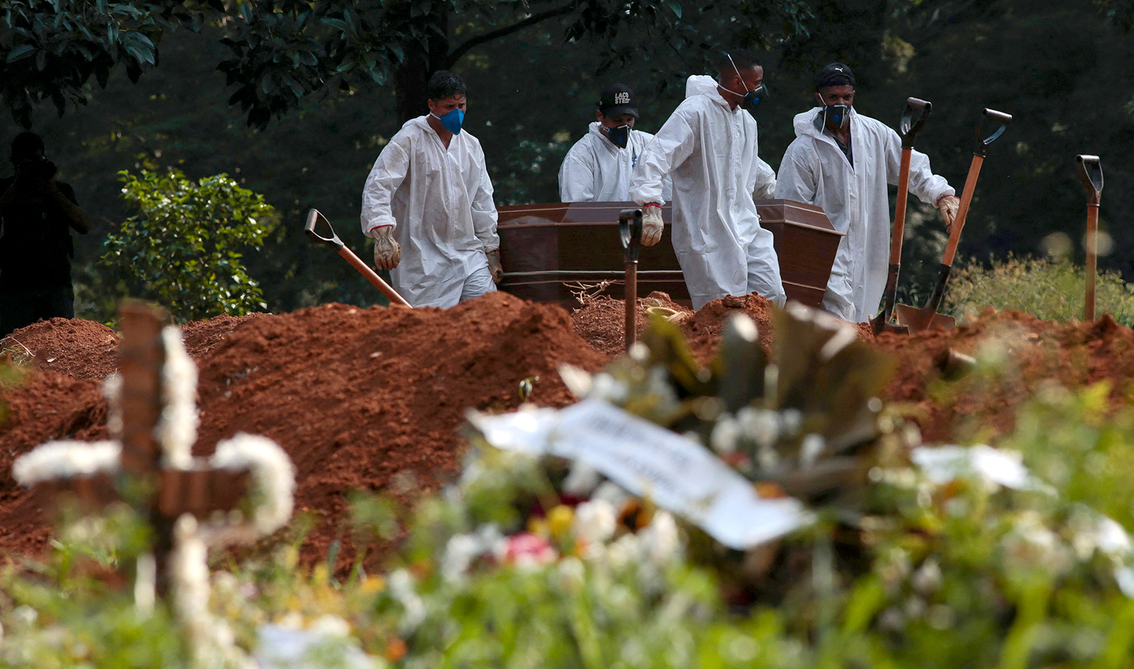 Cemetery workers carry the coffin of a victim of Covid-19 at the Vila Formosa cemetery in Sao Paulo, Brazil, on March 23.