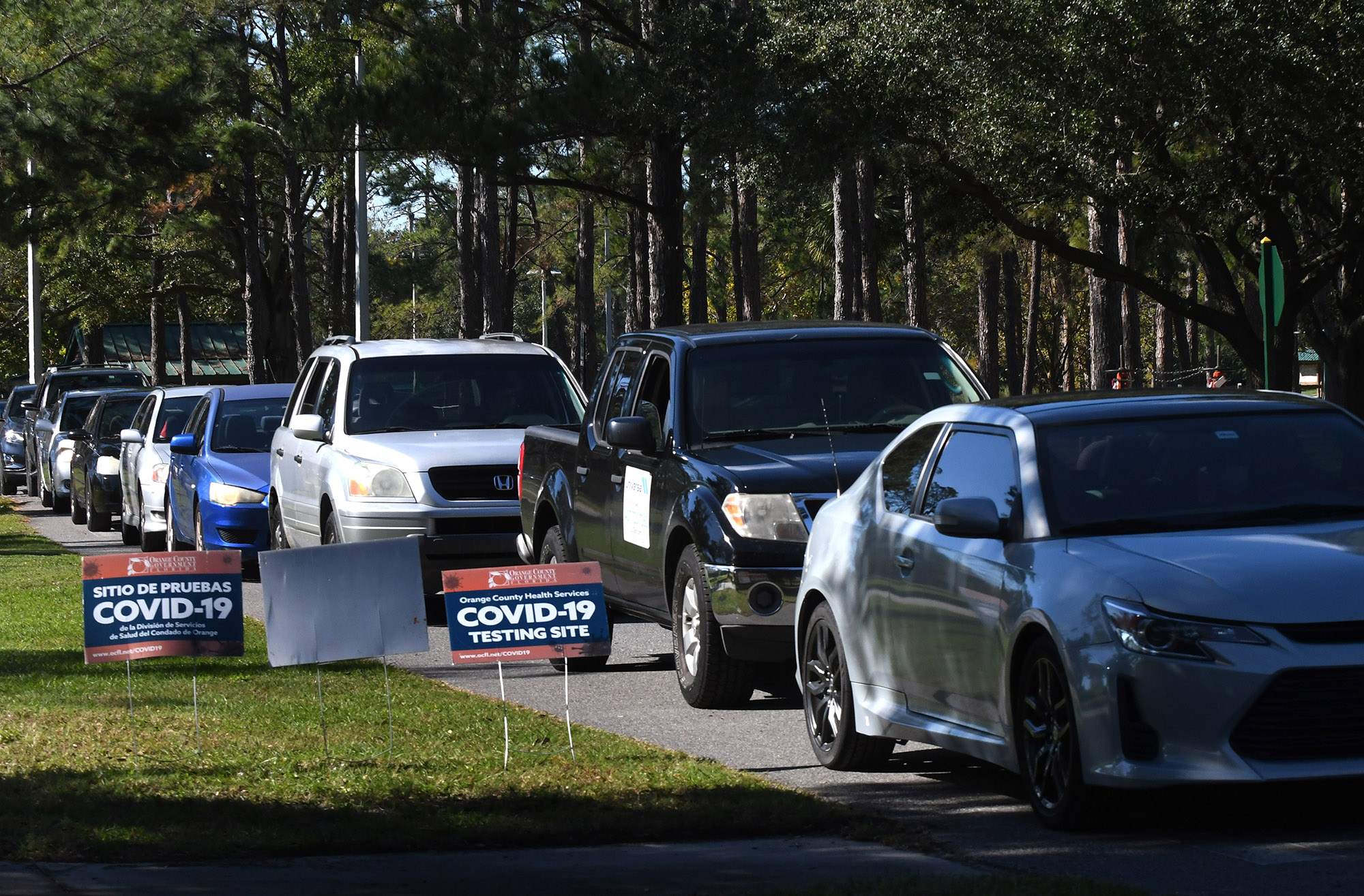 People are seen lined up in their cars at a COVID-19 rapid testing site at Barnett Park in Orlando, Florida on November 23.