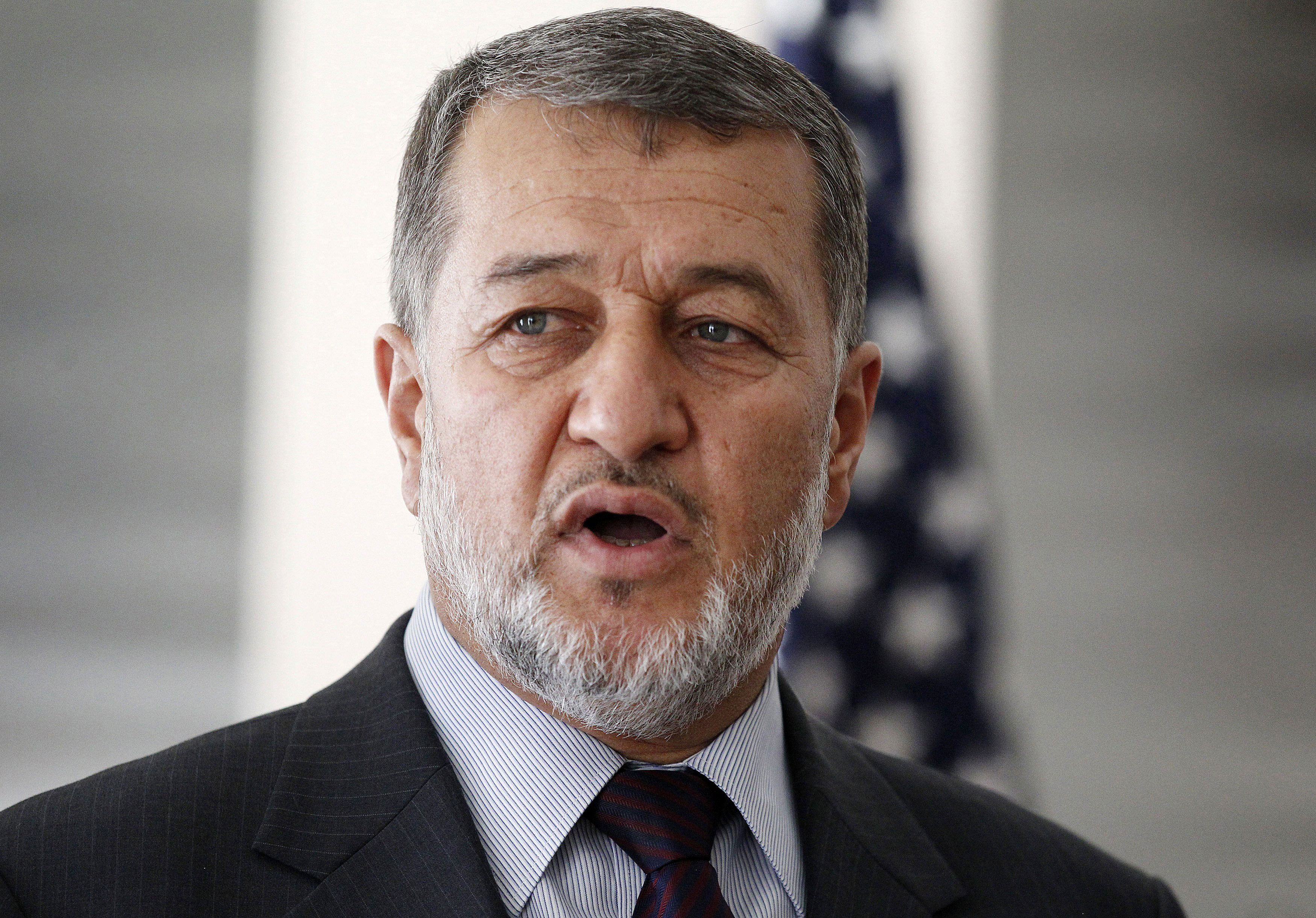 Afghan defense minister curses fleeing President