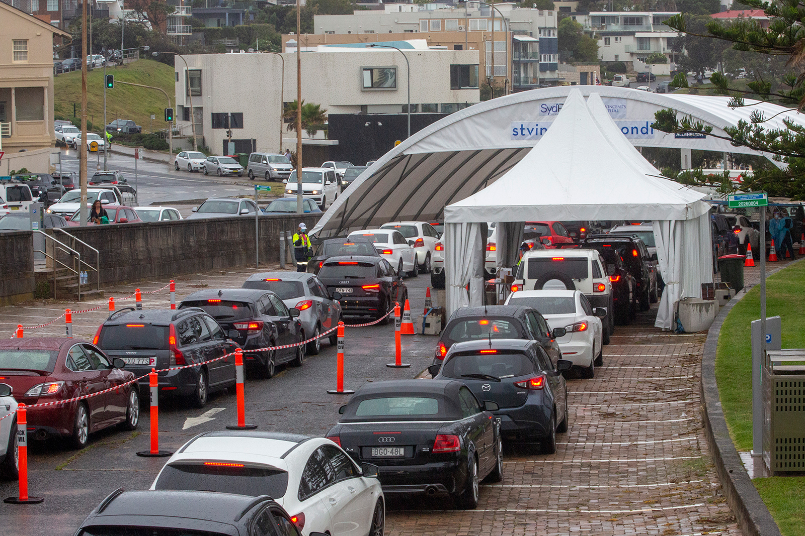 Cars wait in line at a Bondi Beach Covid-19 drive-through testing clinic on December 21, in Sydney, Australia.