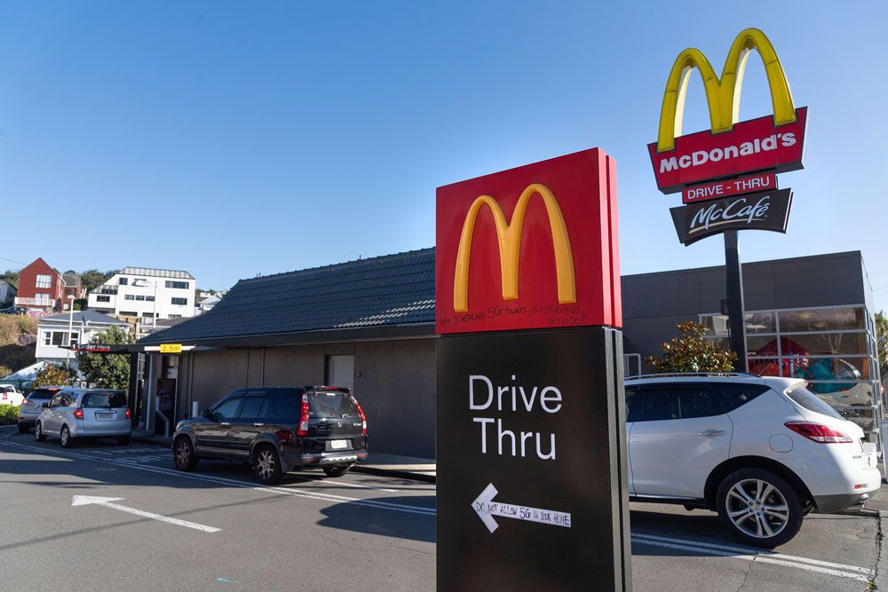 "Customers queue up for the ""drive-thru"" at a McDonald's restaurant on the first day of the easing of restrictions in Wellington on April 28."