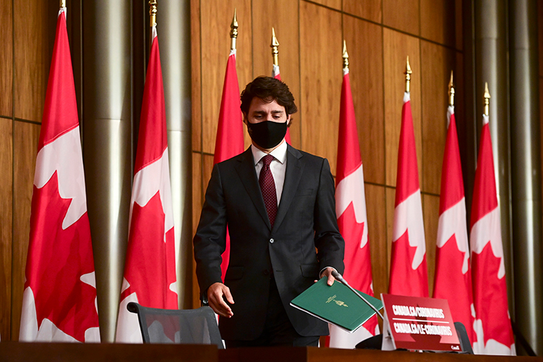 Canada's Prime Minister Justin Trudeau arriving at a press conference to discuss the COVID-19 pandemic in Ottawa, Ontario, on Tuesday, Oct. 13, 2020.