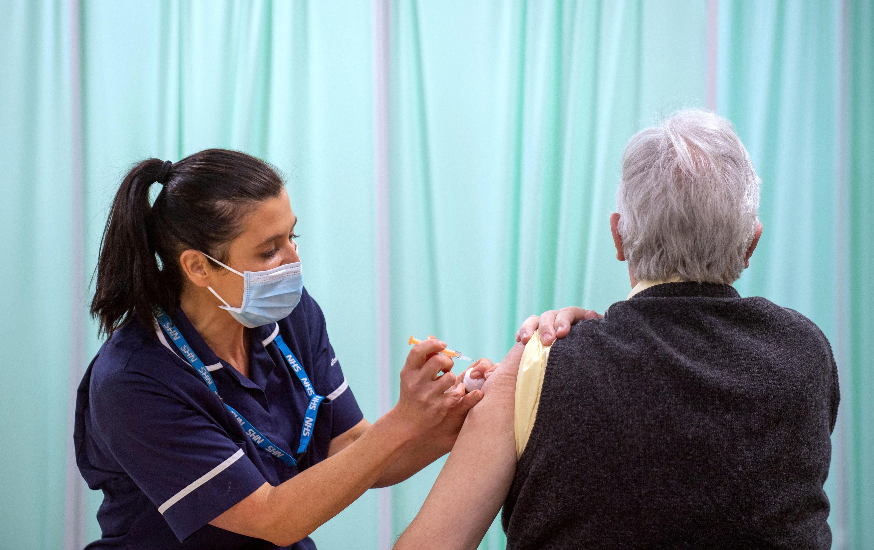 A patient receives an injection of a Covid-19 vaccine at the NHS vaccine centre at Robertson House on January 11 in Stevenage, England.