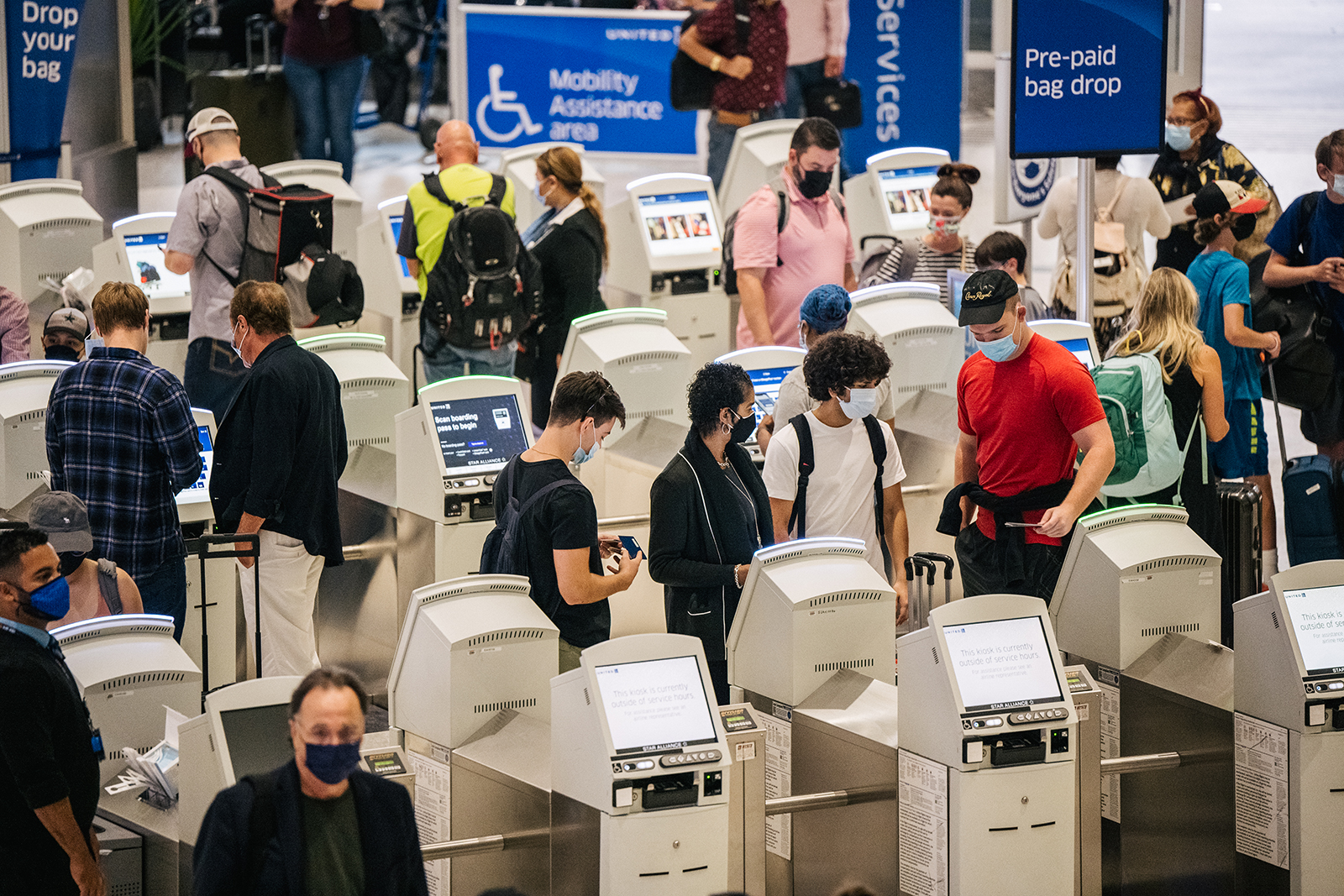 People check in for departure flights at the George Bush Intercontinental Airport on August 5, 2021 in Houston.