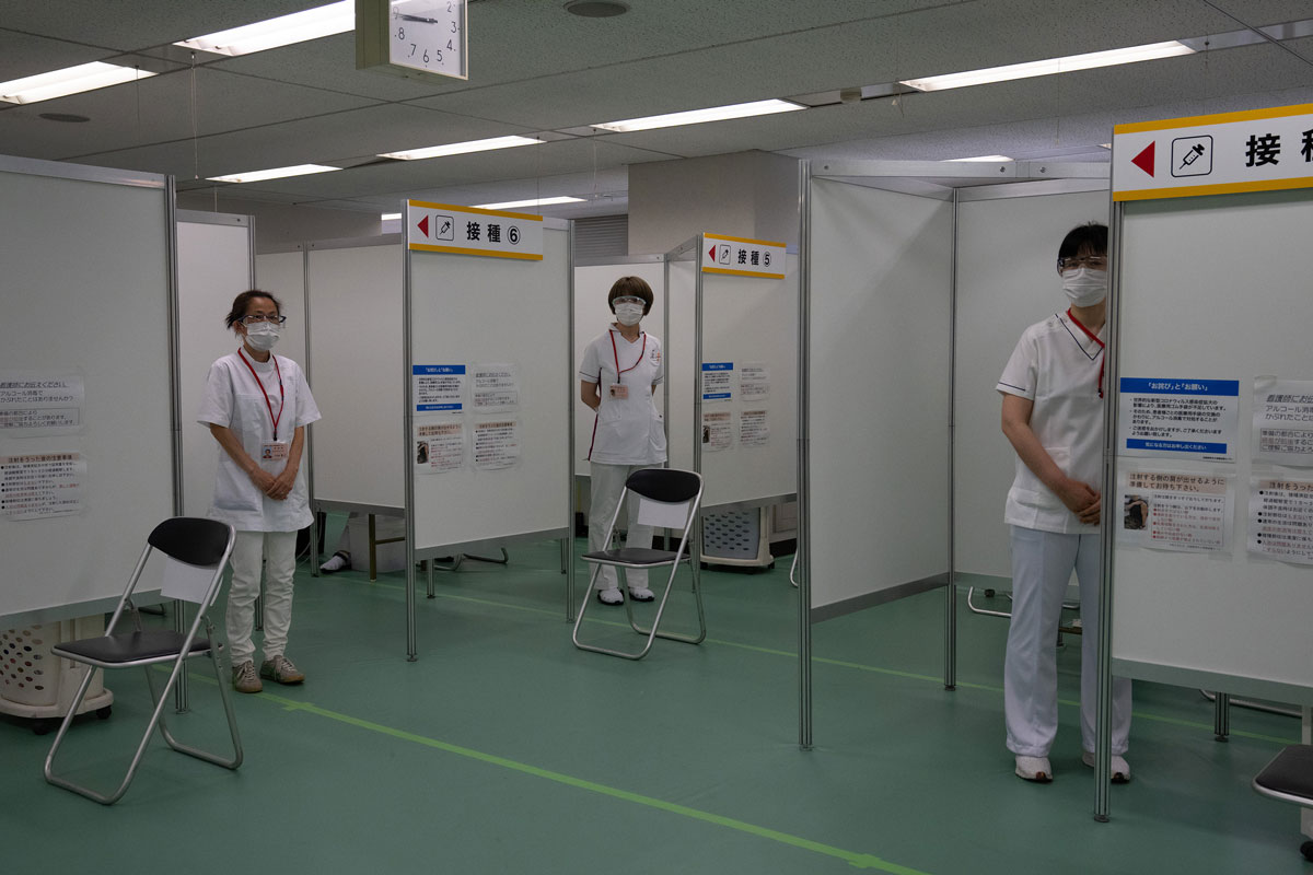 Nurses wait to inoculate people with the Moderna coronavirus vaccine at the newly-opened mass vaccination centre in Tokyo, Japan on May 24.