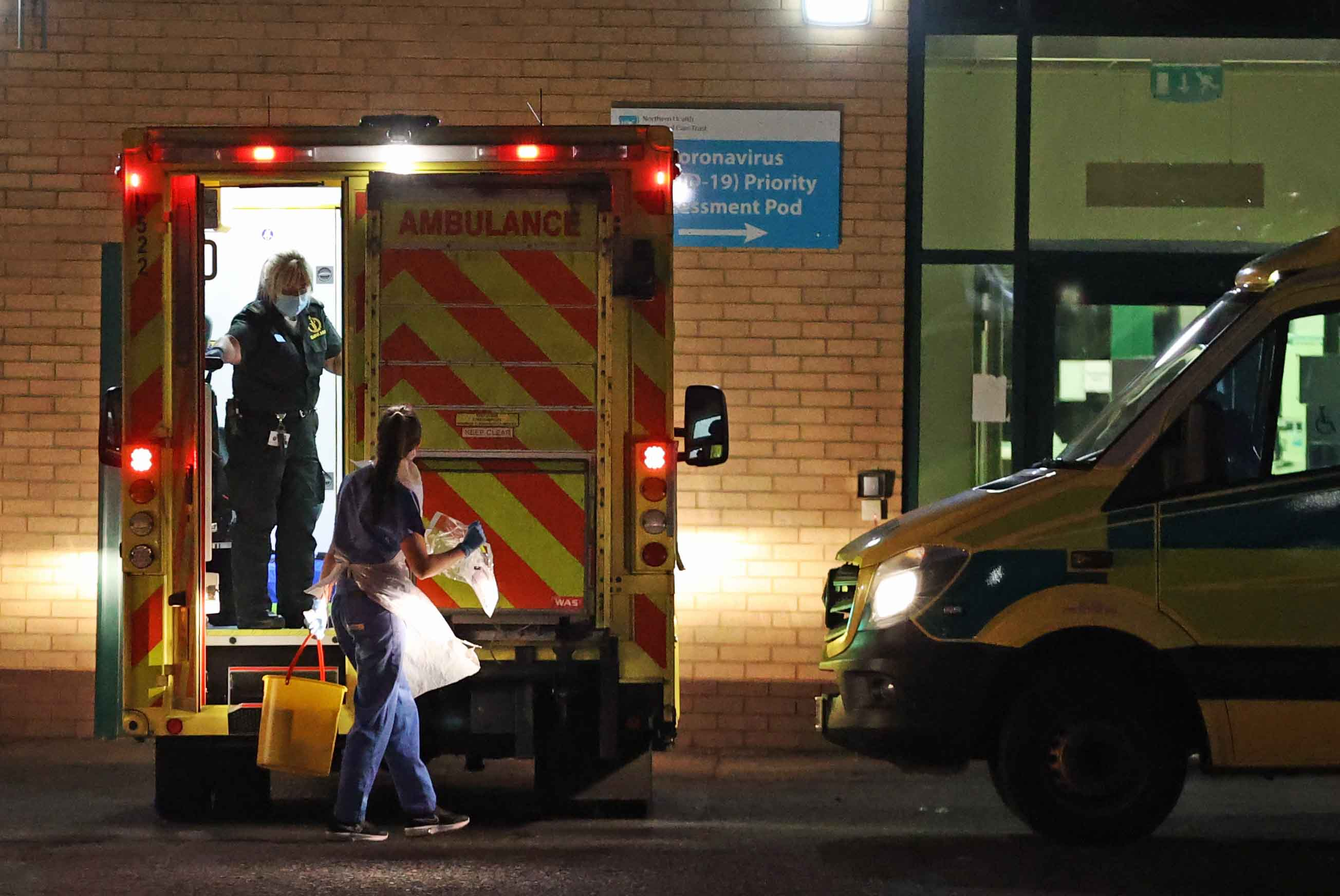 Medical staff attend to a patient in anambulance at Antrim Area Hospital inNorthernIreland on Tuesday, December 15.