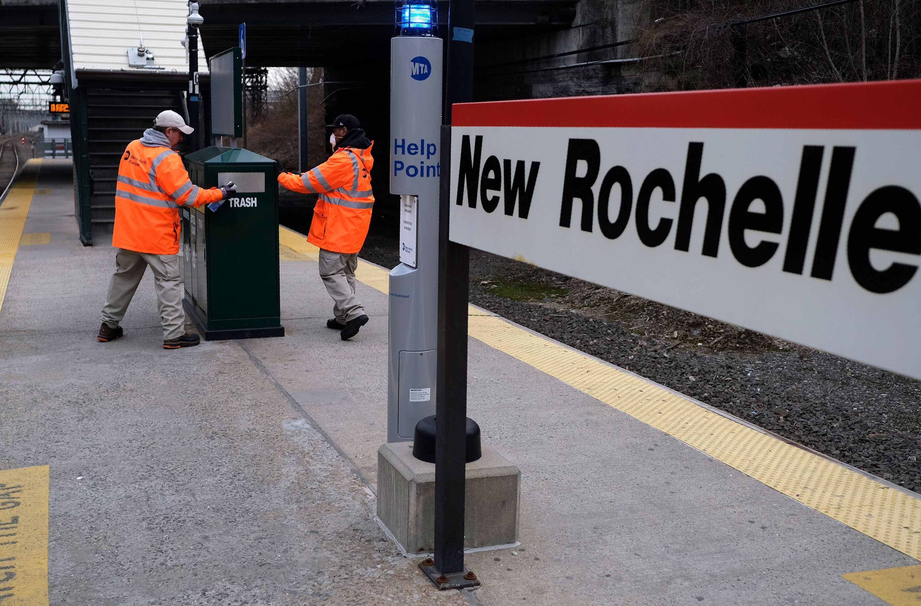 Employees of Metro-North Railroad disinfect parts of the New Rochelle Metro-North station in New Rochelle, New York, on Thursday, March 12.