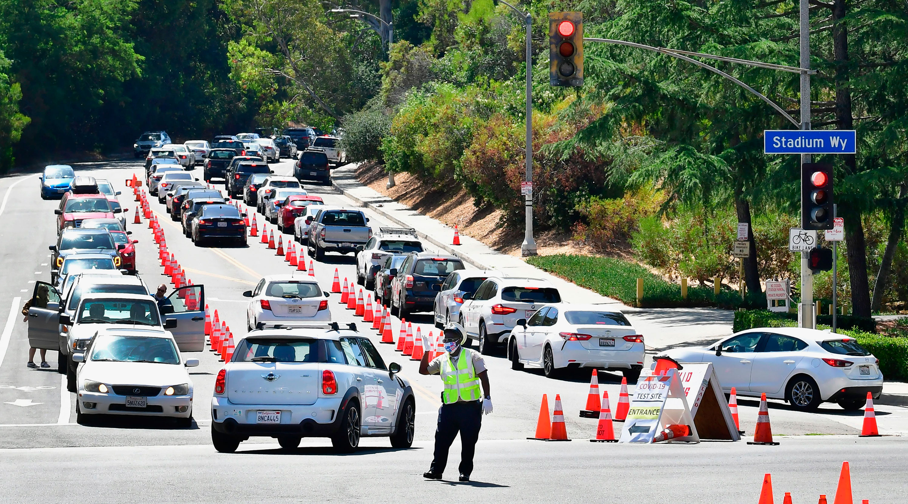 Traffic is directed at Dodger Stadium as people arrive for Covid-19 testing on June 30 in Los Angeles, California.