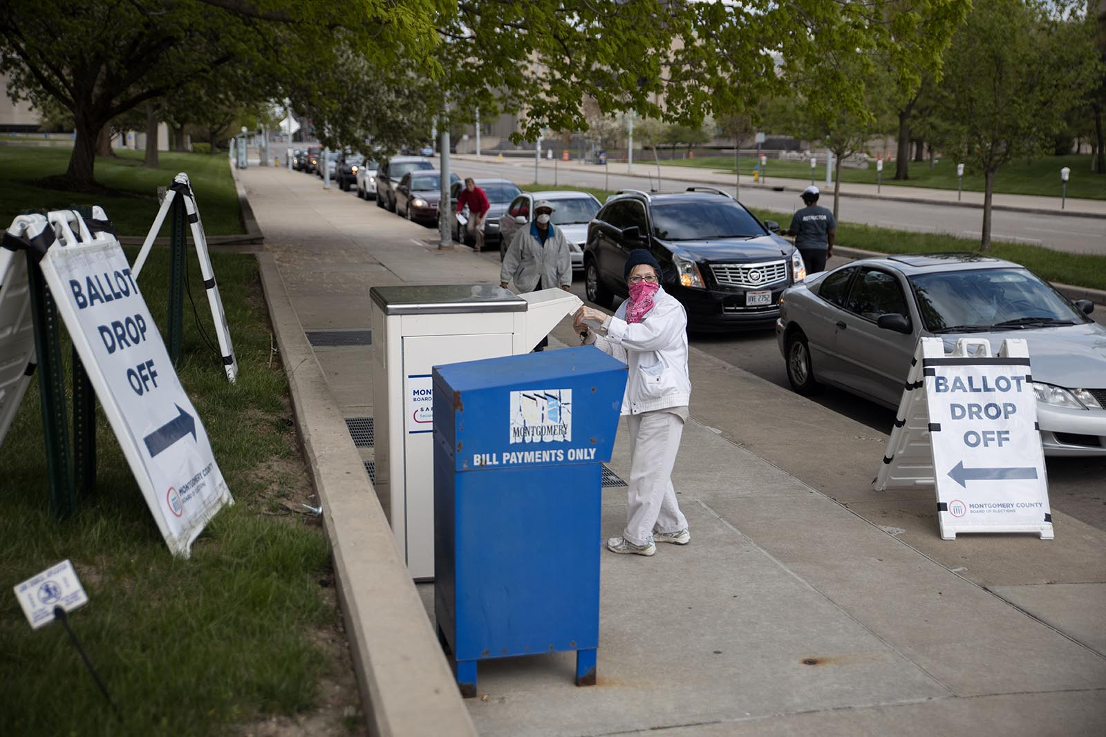 Ohio voters line up in their cars to drop off their ballots at the Board of Elections in Dayton, Ohio on April 28.