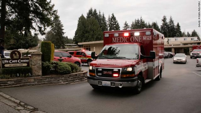 An ambulance transports a patient from the Life Care Center of Kirkland, the long-term care facility linked to the two of three confirmed coronavirus cases in the state, in Kirkland, Washington, U.S. March 1.