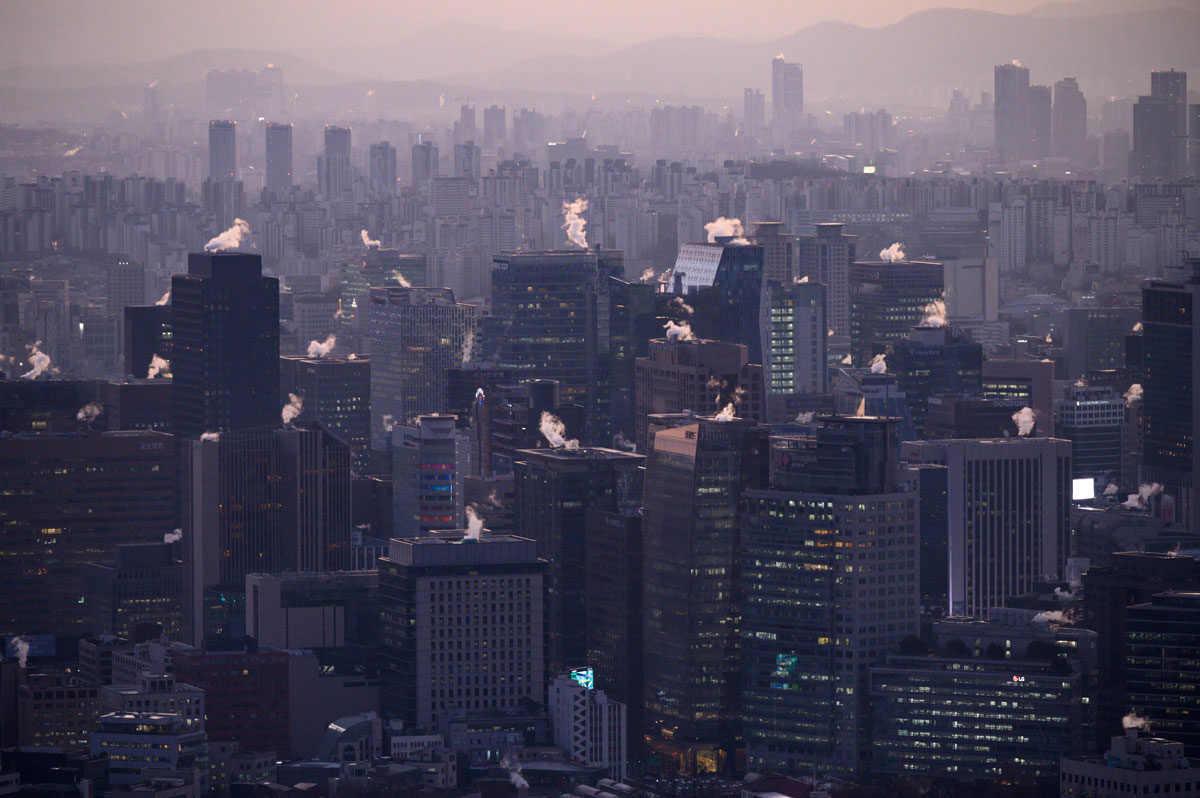 A general view shows the Seoul city skyline and landmark Namsan tower early on December 16.