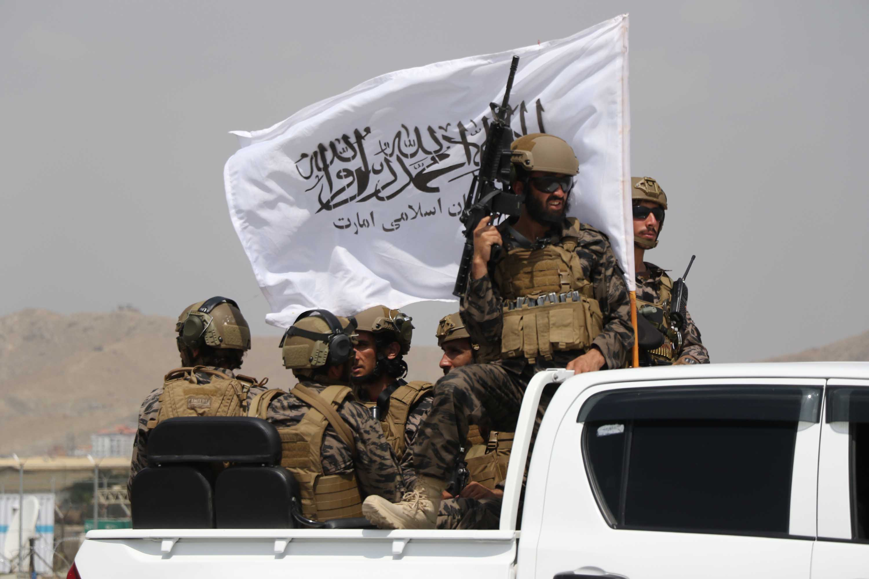 Members of the Taliban take control of Hamid Karzai International Airport after the completion of the U.S. withdrawal from Afghanistan on August 31.