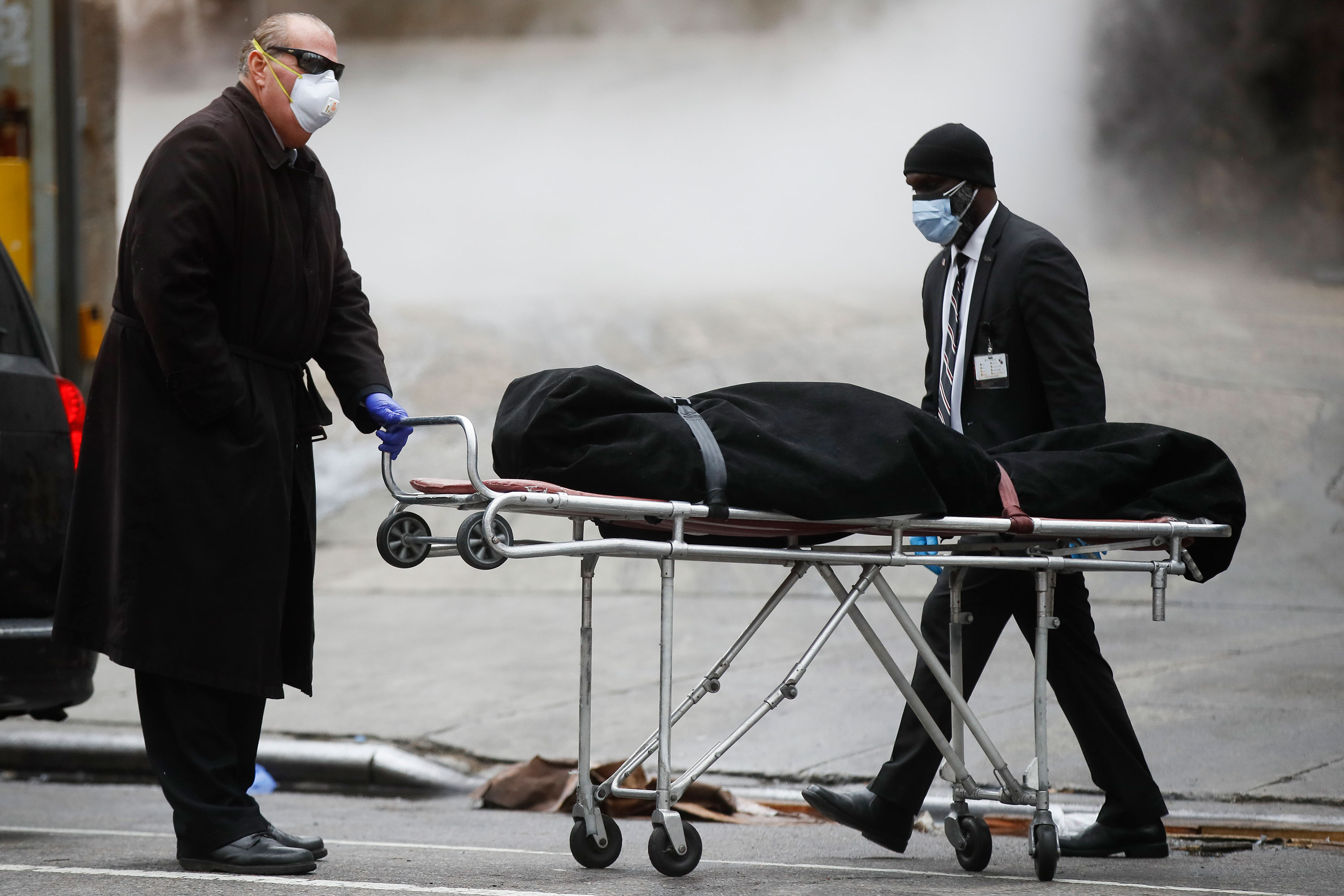 A funeral director collects a body from The Brooklyn Hospital Center in New York on April 9.