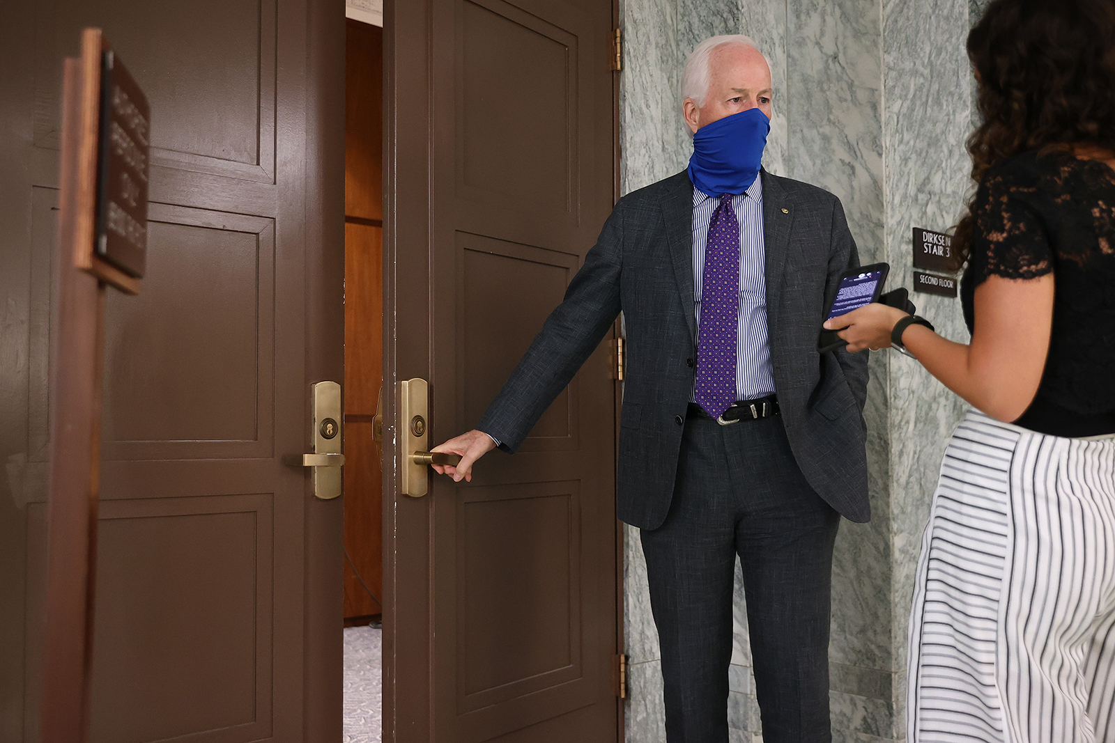 Sen. John Cornyn talks to a reporter as he arrives for the weekly Senate Republican policy luncheon on Tuesday in Washington.