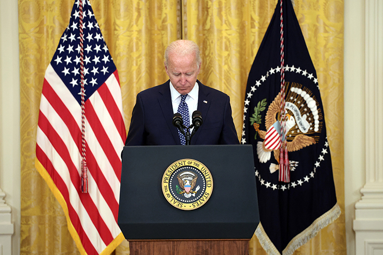 U.S. President Joe Biden holds a moment of silence for workers who have died from the COVID-19 pandemic as he speaks on workers rights and labor unions in the East Room at the White House on September 08, 2021 in Washington, DC.