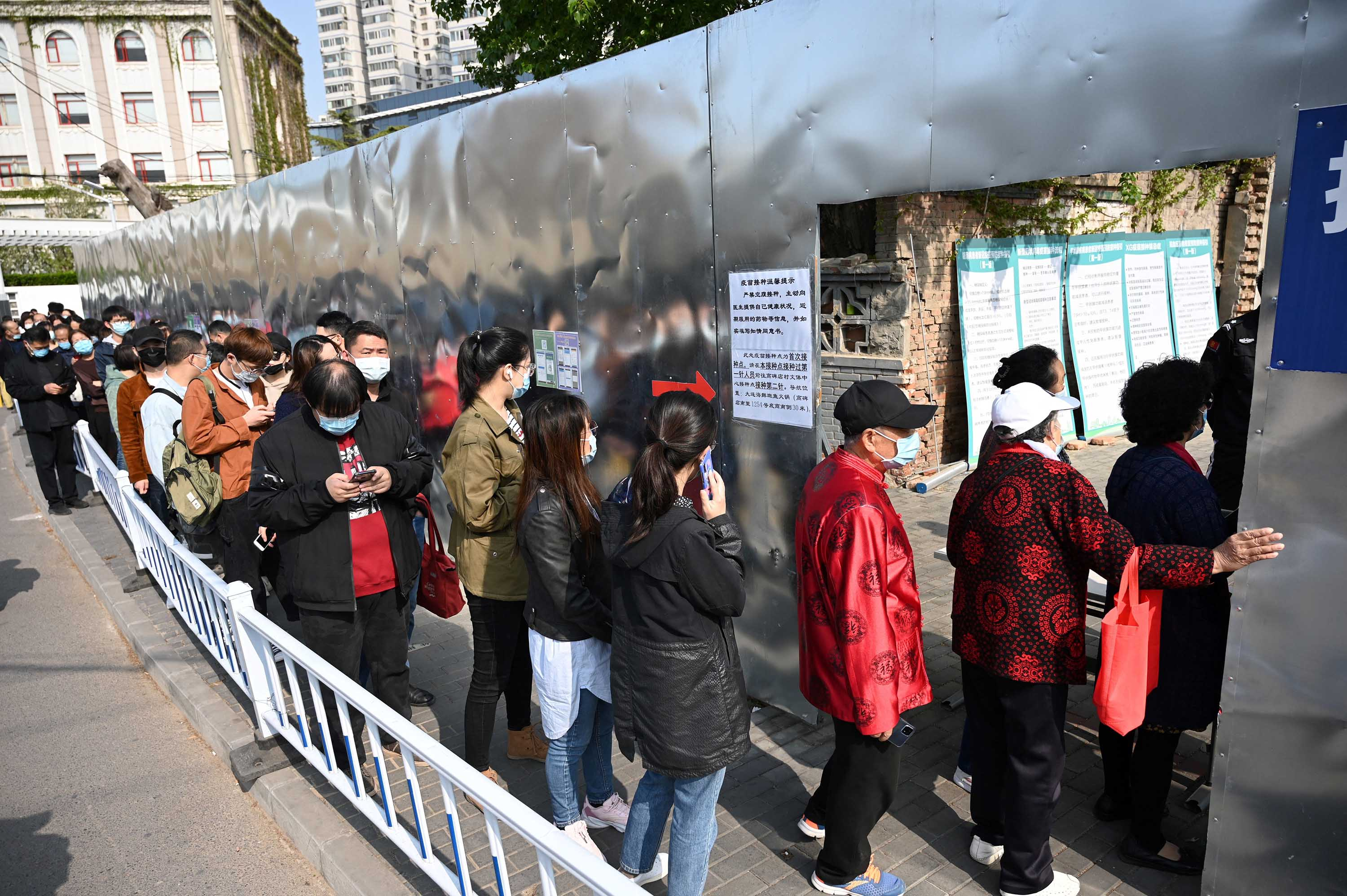 People line up to be vaccinated against Covid-19 outside a residential compound in Beijing, on April 8.