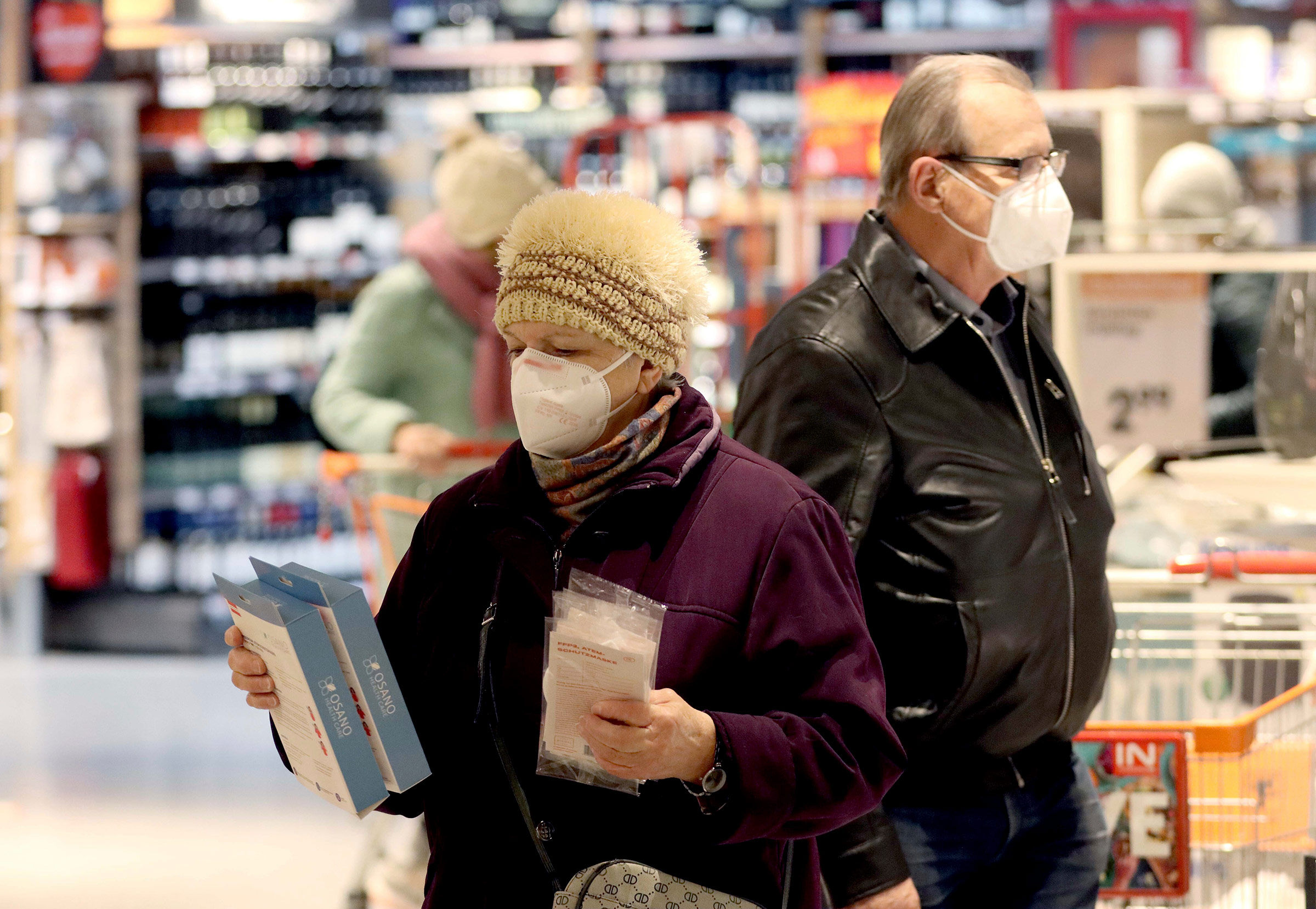 People wear FFP2 protective masks while shopping in a supermarket in Vienna, Austria, on January 25.