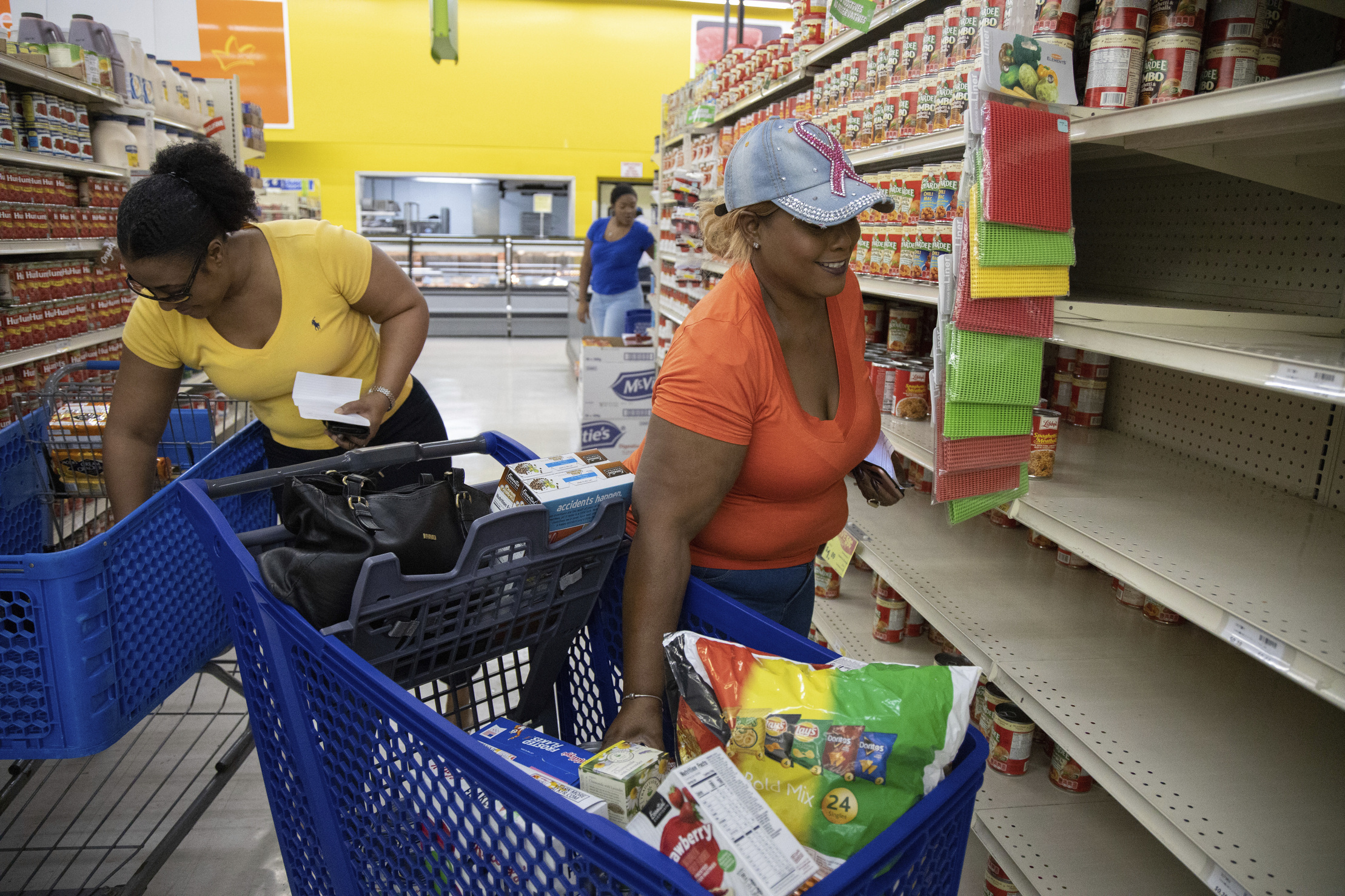 People shop in Freeport, The Bahamas on Friday before Dorian arrives.